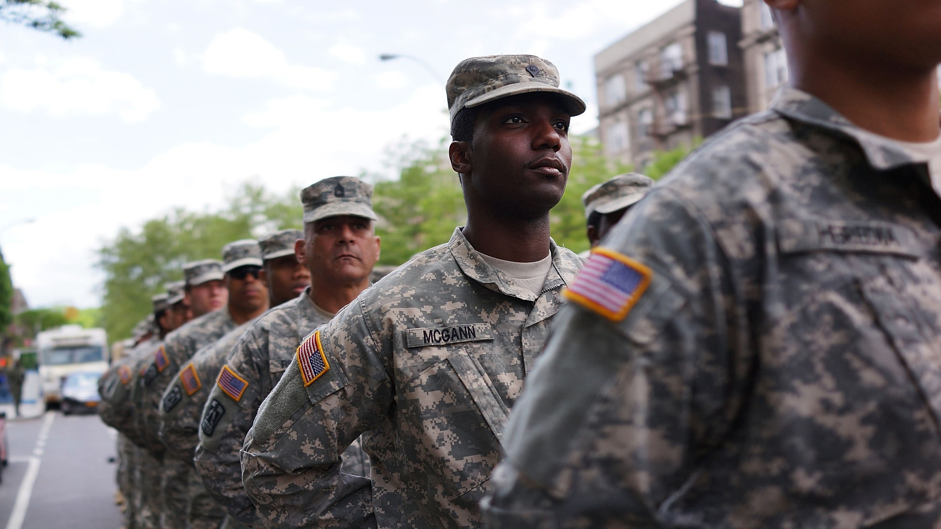 """NEW YORK, NY - MAY 18:  Memebrs of the Army's 369th Infantry Regiment prepare to march with fellow soldiers, boy scouts and various other military aligned groups in the 369th Infantry Regiment Parade in Harlem on May 18, 2014 in New York City. The parade, which takes place on the historic Adam Clayton Powell Jr. Boulevard, looks to celebrate the contribution African Americans and Puerto Ricans have made to military. The 369th was home to the """"Harlem Hellfighters"""", a unit made up of both African Americans and Puerto Ricans, which fought in both World War I and World War II.  (Photo by Spencer Platt/Getty Images)"""