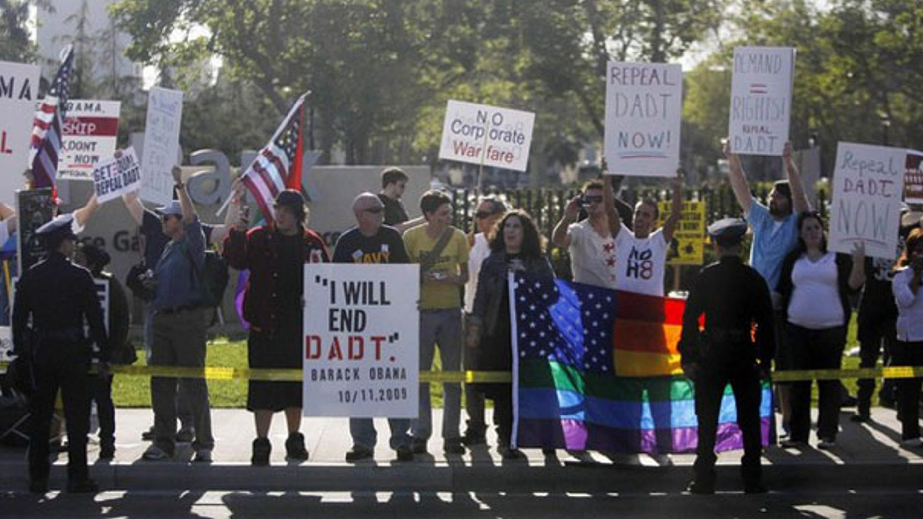 Protesters in favor of repealing the 'Don't Ask, Don't Tell' policy line the motorcade route of President Obama as he passes by in Los Angeles April 19. (Reuters Photo)