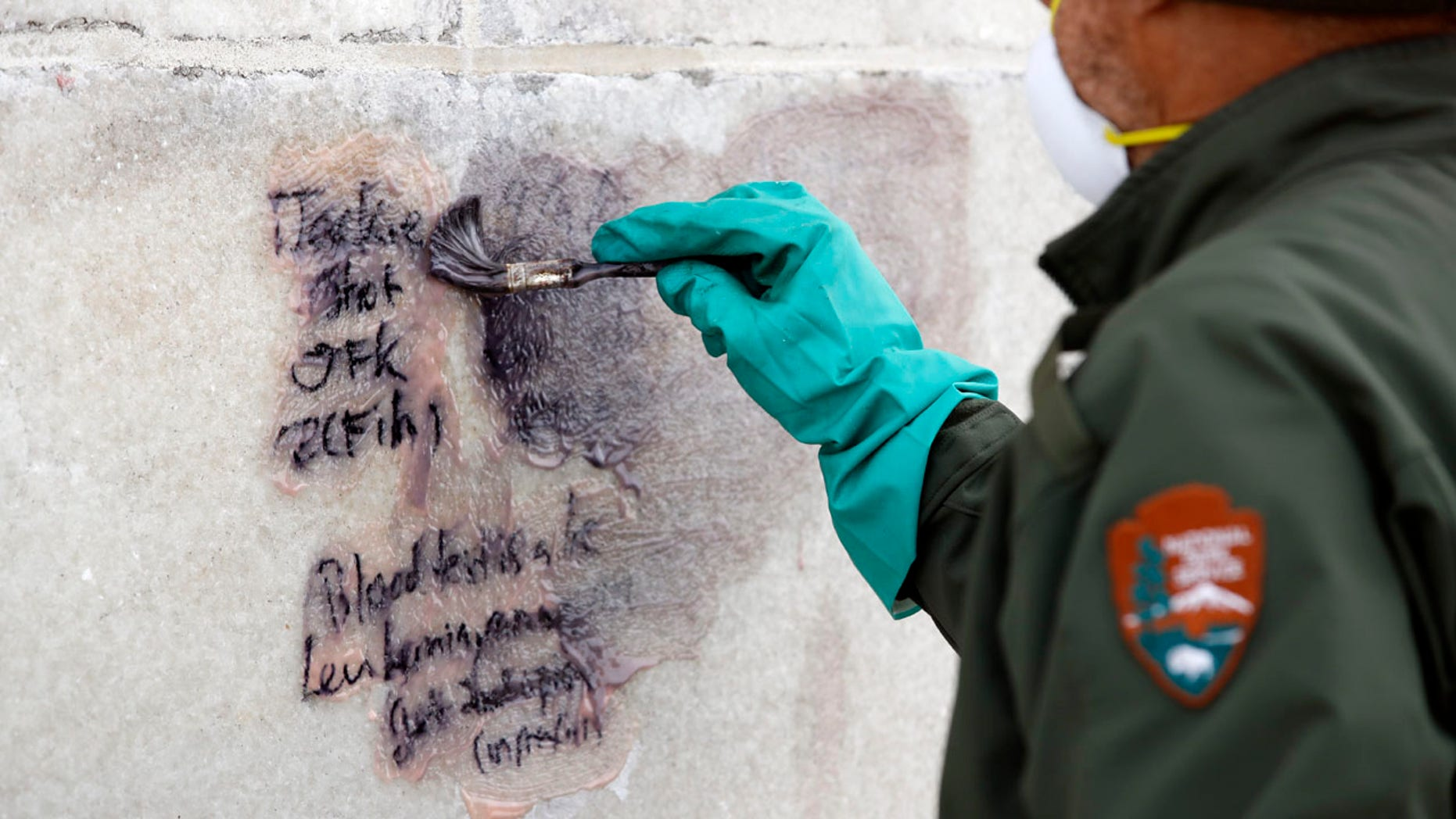 Feb. 21, 2017: A U.S. Park Service employee works to clean graffiti off of the Washington Monument.
