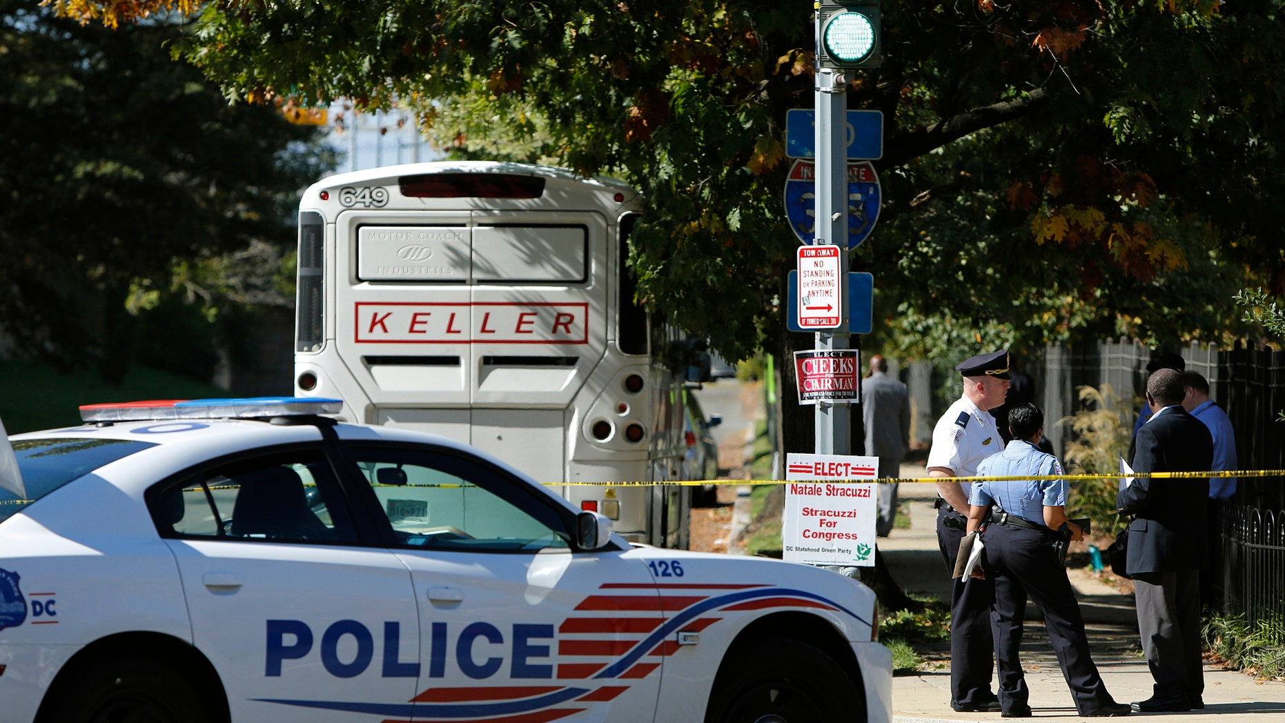 Oct. 17, 2014: A cordoned-off police area is seen near a charter bus after an Ebola scare in Washington.