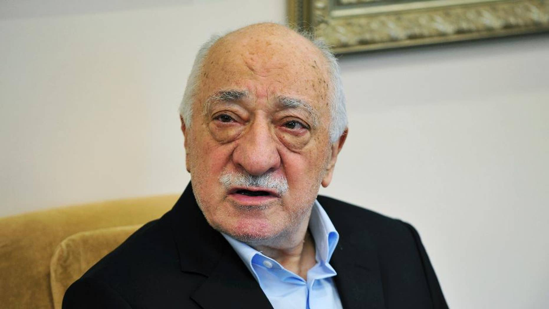 FILE - In this July 17, 2016 file photo, Islamic cleric Fethullah Gulen speaks to members of the media at his compound in Saylorsburg, Pa. A senior U.S. official says there are grounds to take seriously Turkey's contention that a Pennsylvania-based Muslim cleric was involved in the failed July coup attempt. Ankara is accusing Fethullah Gulen of orchestrating the attempted coup and is asking the U.S. to extradite him. Gulen denies any involvement and has condemned the coup.  (AP Photo/Chris Post, File)