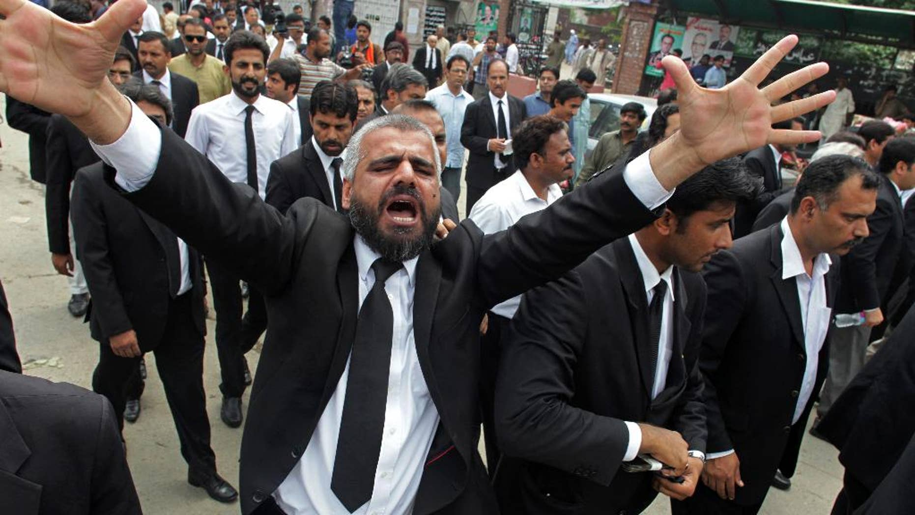 A Pakistan lawyer shouts slogans during a demonstration to condemn a suiciding bombing in Quetta that killed dozens of people and wounded many more, in Lahore, Pakistan, Monday, Aug. 8, 2016. Senior police official Zahoor Ahmed Afridi says the blast took place shortly after the body of a prominent lawyer, killed in a shooting attack earlier in the day, was brought to the hospital. It's unclear if the two events are in any way connected. (AP Photo/K.Chaudary)