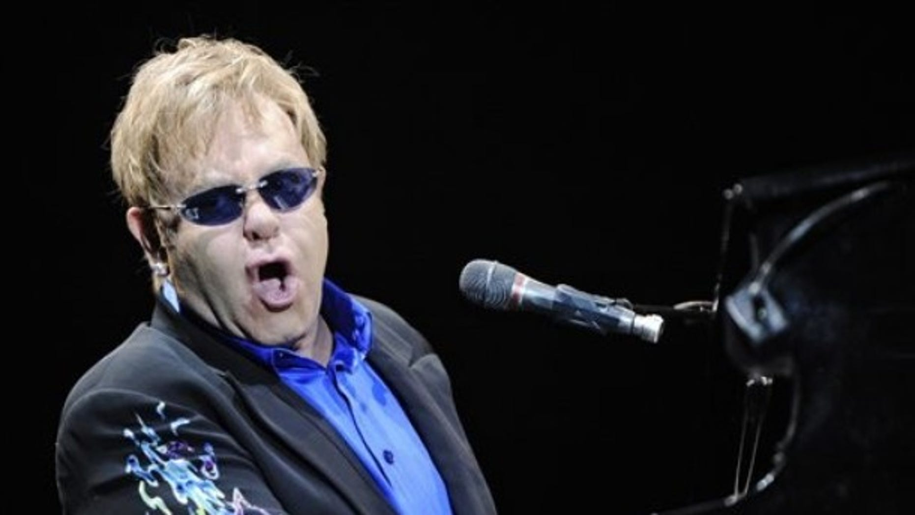 British pop singer and composer Elton John performs in Kosice, Slovakia, Tuesday, June 22, 2010. (AP Photo/CTK, Peter Lazar) **SLOVAKIA OUT**