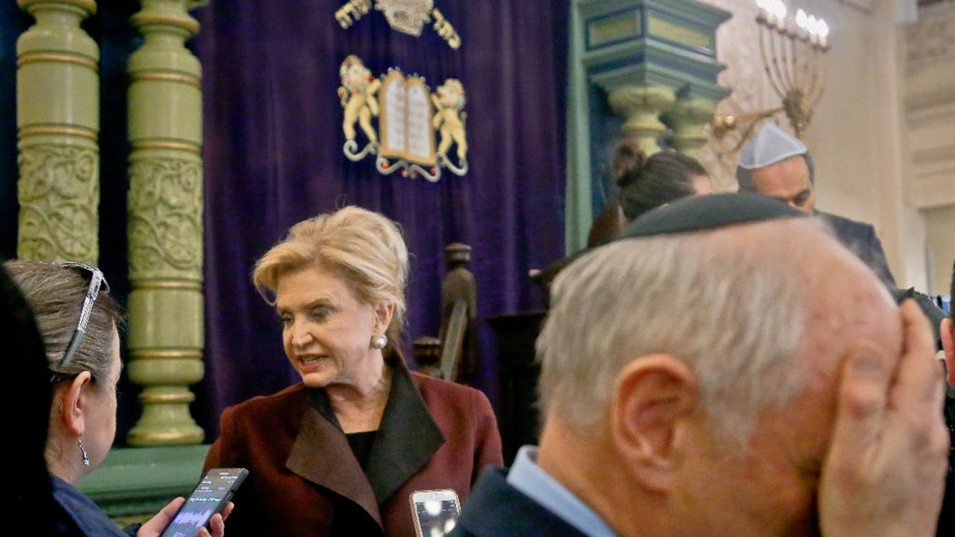 FILE - In this March 3, 2017, file photo, Congresswoman Carolyn Maloney, center, a member of Congress's bipartisan task force combating anti-Semitism, speaks with a reporter after holding a news conference to address bomb treats against Jewish organizations and vandalism at Jewish cemeteries at the Park East Synagogue in New York. Kendall Sullivan, a Connecticut man who posted threats against Jews and synagogues on a metal music internet forum plans to argue at his sentencing that he has served enough time in prison. Sullivan is scheduled to go before a U.S. District judge in Bridgeport on Monday, April 17. He pleaded guilty in January to perpetrating a hoax and originally faced three federal charges of making online threats. (AP Photo/Bebeto Matthews, File)
