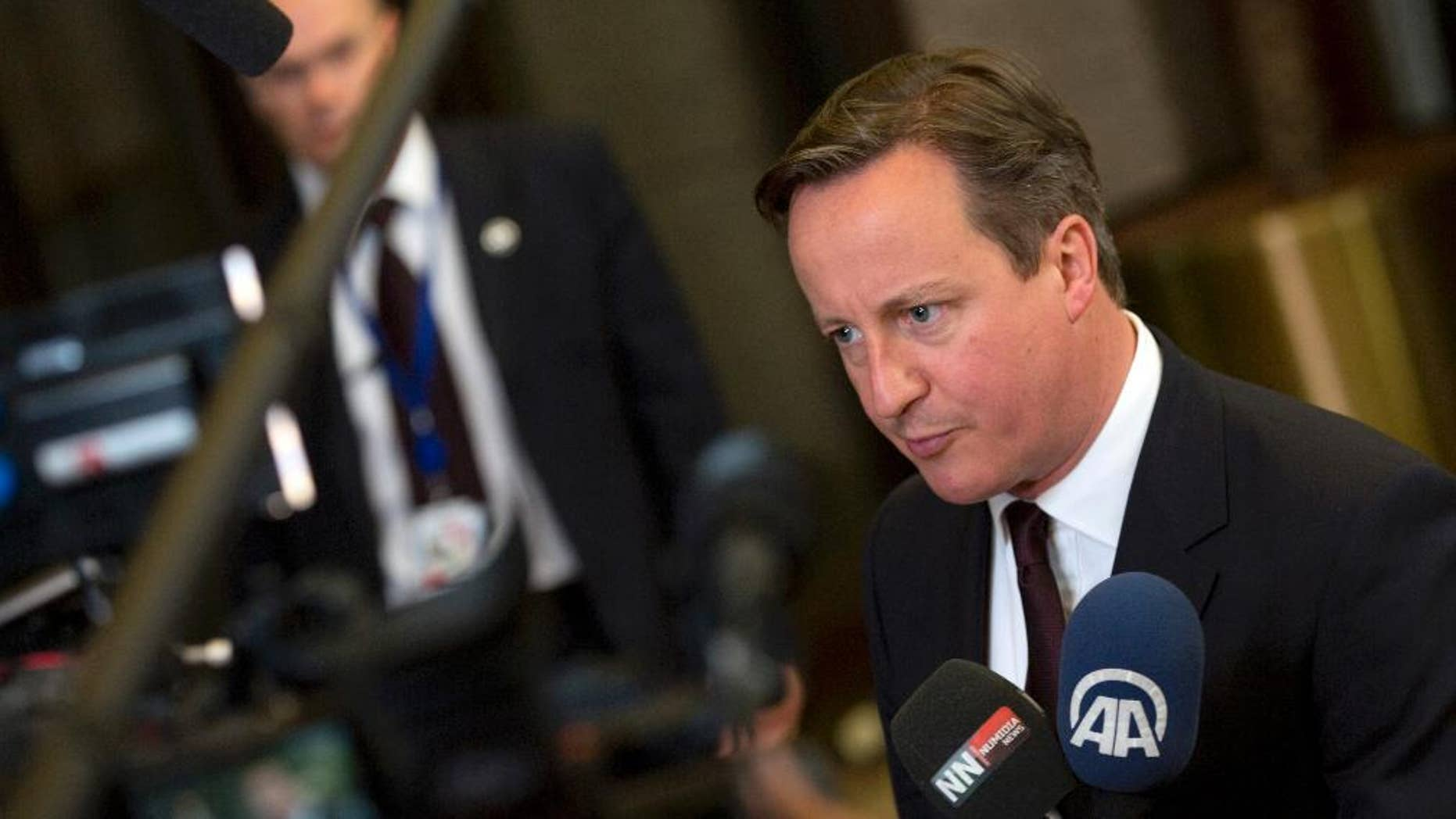British Prime Minister David Cameron speaks with the media after an EU summit in Brussels on Friday, June 26, 2015. European leaders have tasked finance ministers from the euro countries with concluding a debt financing agreement with Greece over the weekend, just days before Athens has to meet a crucial debt deadline. (AP Photo/Virginia Mayo)