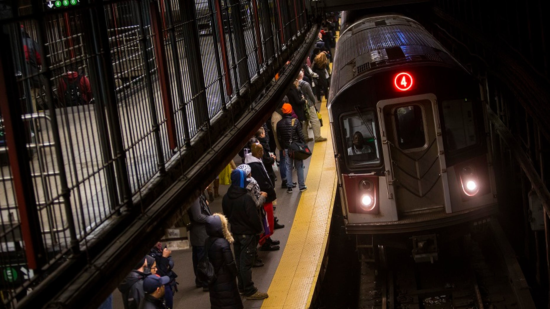 A woman was pushed onto the tracks of a New York City subway on Tuesday night, police said.