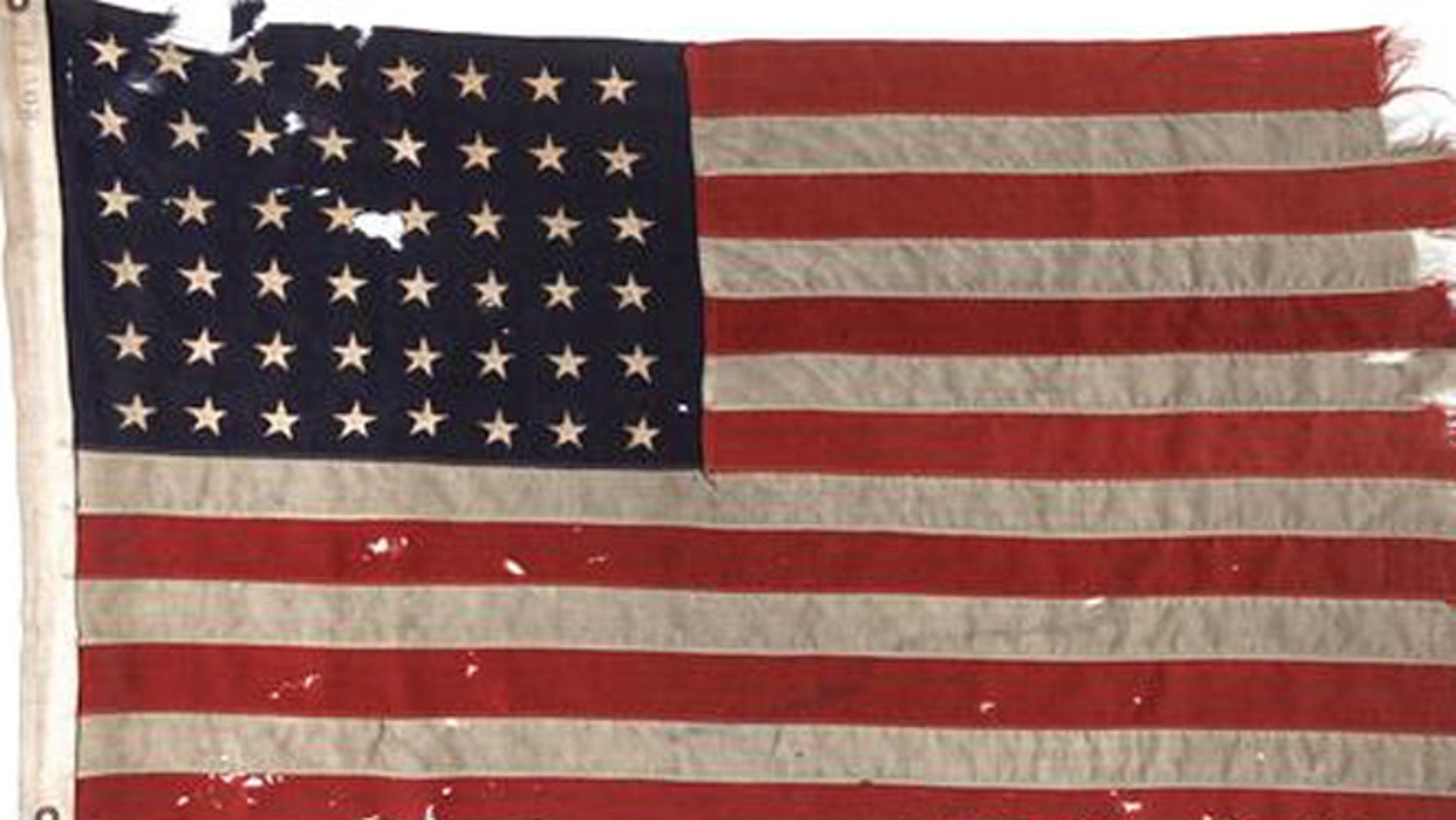 This undated photo provided by Heritage Auctions shows a U.S. flag flown on the stern of the boat that led the first American troops onto Utah Beach on D-Day.