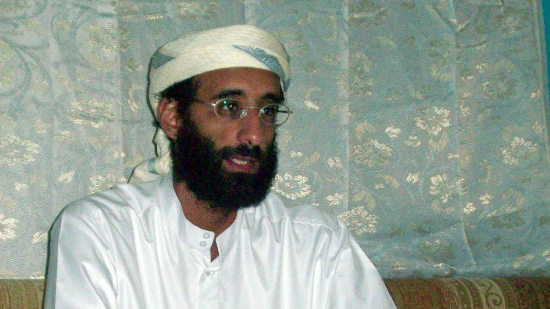 FILE - This October 2008, file photo shows Imam Anwar al-Awlaki in Yemen. Investigators say the blast that rocked New York's Chelsea neighborhood on Sept. 17, 2016, that injured more than two dozen people, was the latest in a long line of incidents in which the attacker was inspired by al-Awlaki, the American imam-turned al-Qaida propagandist who was killed by a U.S. drone strike five years ago. (AP Photo/Muhammad ud-Deen, File)