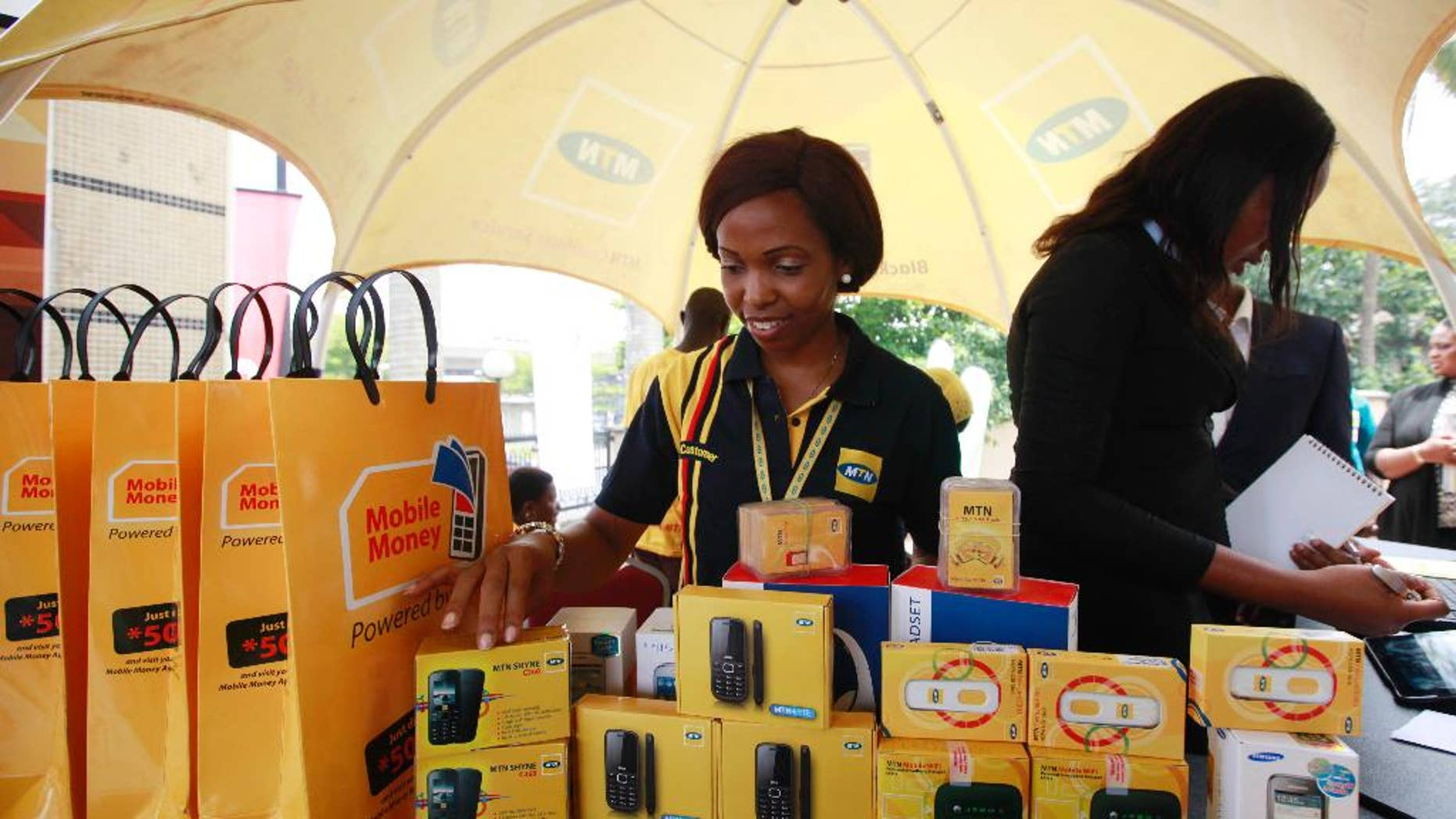 FILE- In this Monday April. 22, 2013 file photo, staff of MTN Nigeria workduring the launch of mobile number portability in Lagos, Nigeria. MTN Group telecommunication's stock plunged 12.5 percent on the Johannesburg Stock Exchange Monday, Oct. 26, 2015 on the news that its most lucrative subsidiary, in Nigeria, has been fined $5.2 billion for failing to disconnect millions of unregistered cellphone subscribers.The Nigerian Communications Commission confirmed the penalty based on 200,000 naira ($1,000) for each of 5.1 million cellphone SIM cards that had not been registered and should have been disconnected by an August deadline.  (AP Photo/Sunday Alamba file)