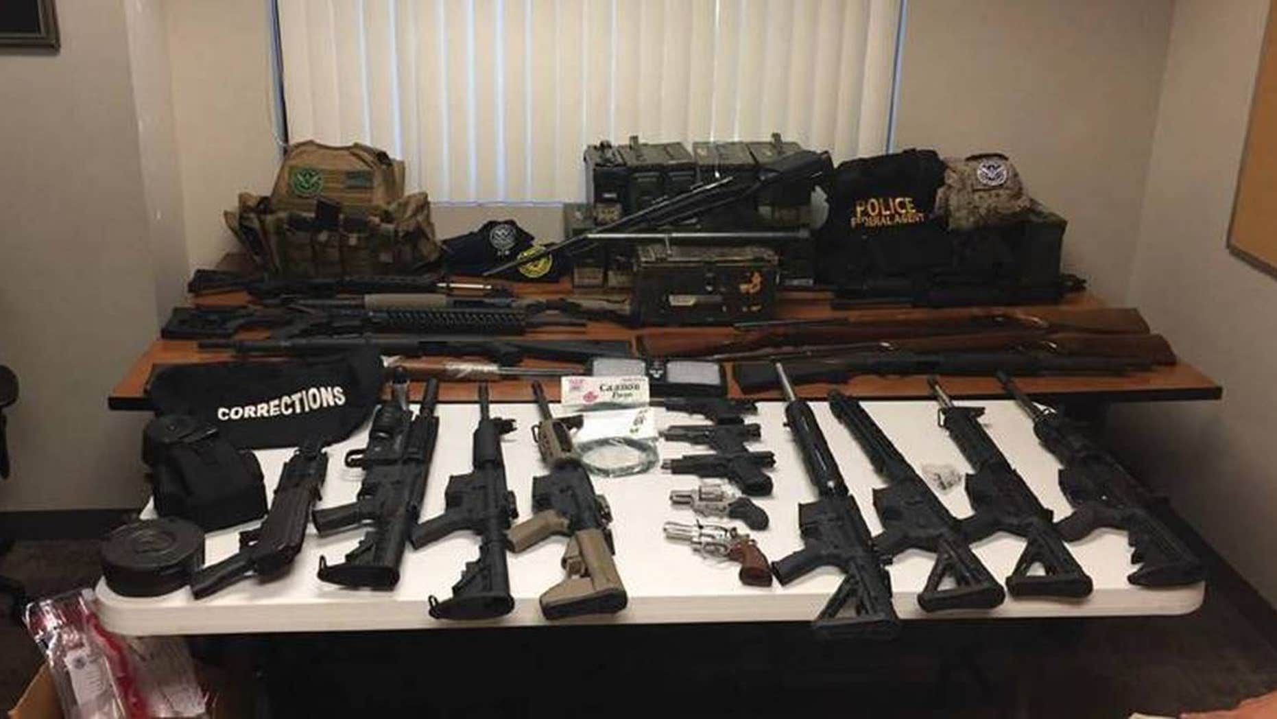 A search of Johnston's house yielded a cache of weapons and explosive devices, federal prosecutors said.