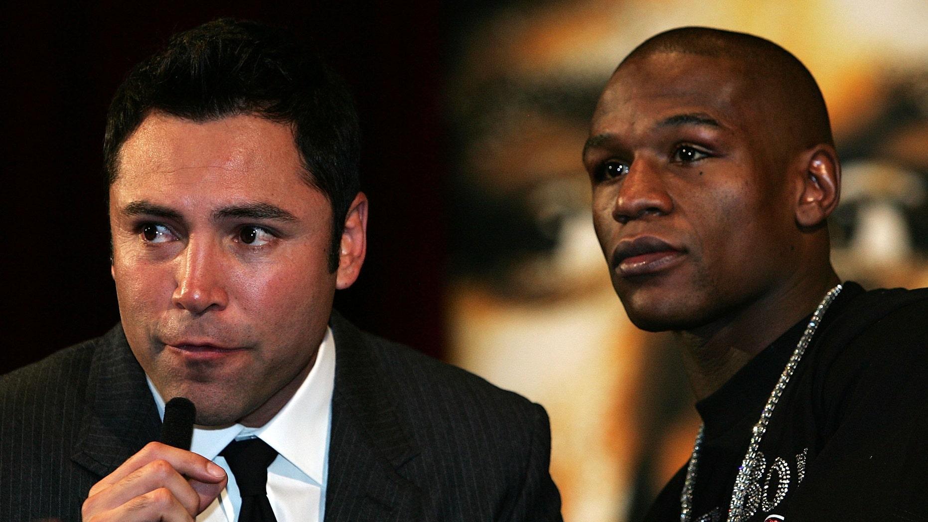 Promoter Oscar De La Hoya speaks alongside Floyd Mayweather Jr. (Photo by John Gichigi/Getty Images)
