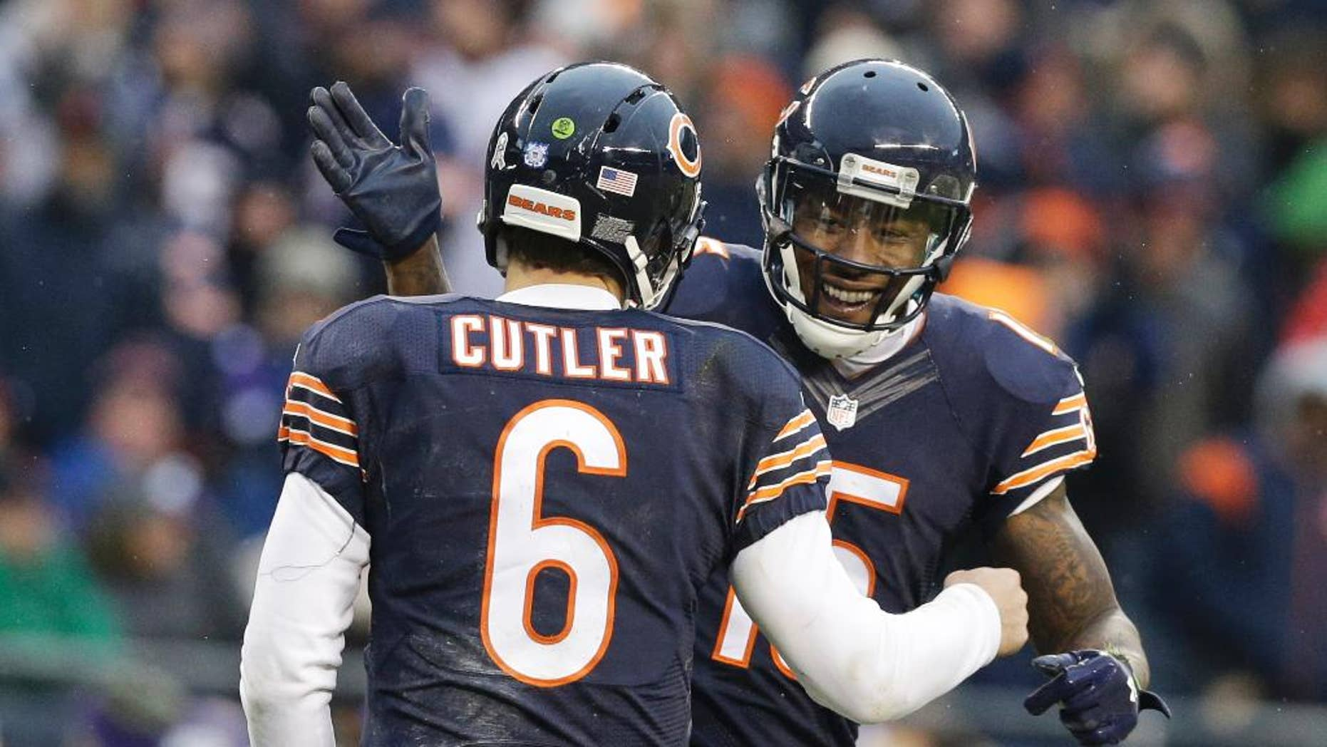 Chicago Bears receiver Brandon Marshall (15) celebrates his touchdown reception with quarterback Jay Cutler (6) during the second half of an NFL football game against the Minnesota Vikings Sunday, Nov. 16, 2014 in Chicago. (AP Photo/Nam Y. Huh)
