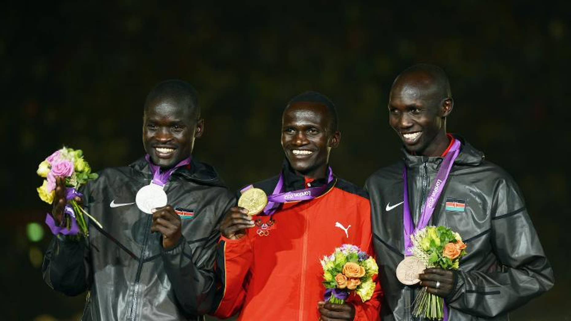 Uganda??'s gold medalist Stephen Kiprotich (centre), Kenya'??s silver medalist Abel Kirui (left) and bronze medalist Wilson Kipsang Kiprotich during the closing ceremony of the 2012 London Olympic Games on August 12