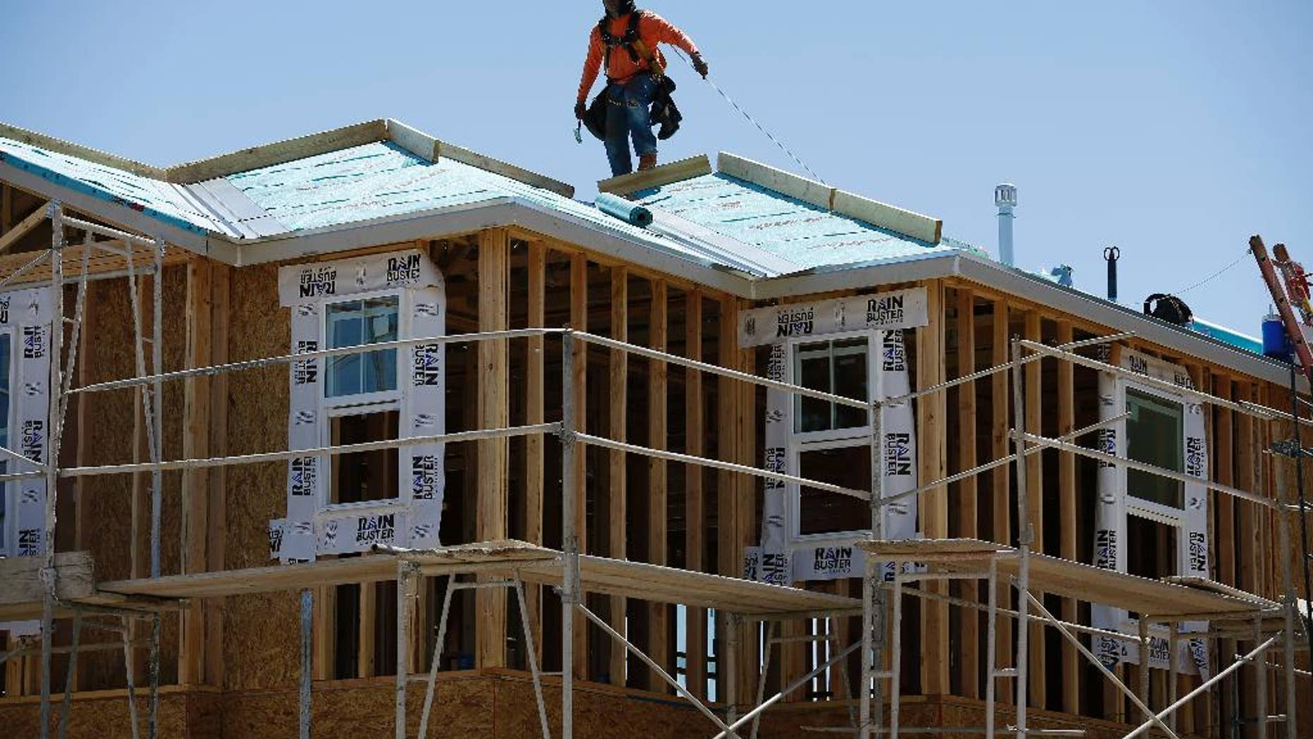 In this April 13, 2015, photo, a worker helps to build a new home in Las Vegas. The Conference Board releases its index of leading indicators for April on Thursday, May 21, 2015. (AP Photo/John Locher)