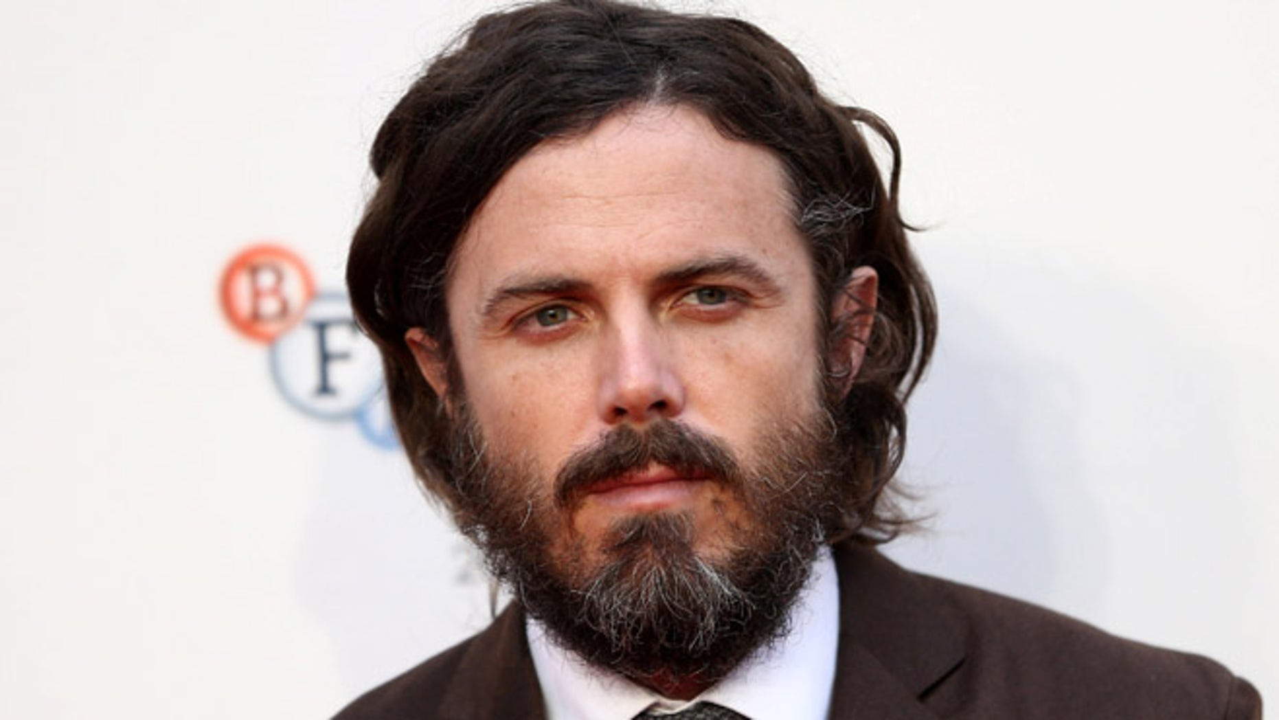 """Actor Casey Affleck poses for photographers at a Gala screening of his film """"Manchester by the Sea"""" at the 60th BFI London Film Festival in London, Britain October 8, 2016. REUTERS/Neil Hall - RTSRDOZ"""