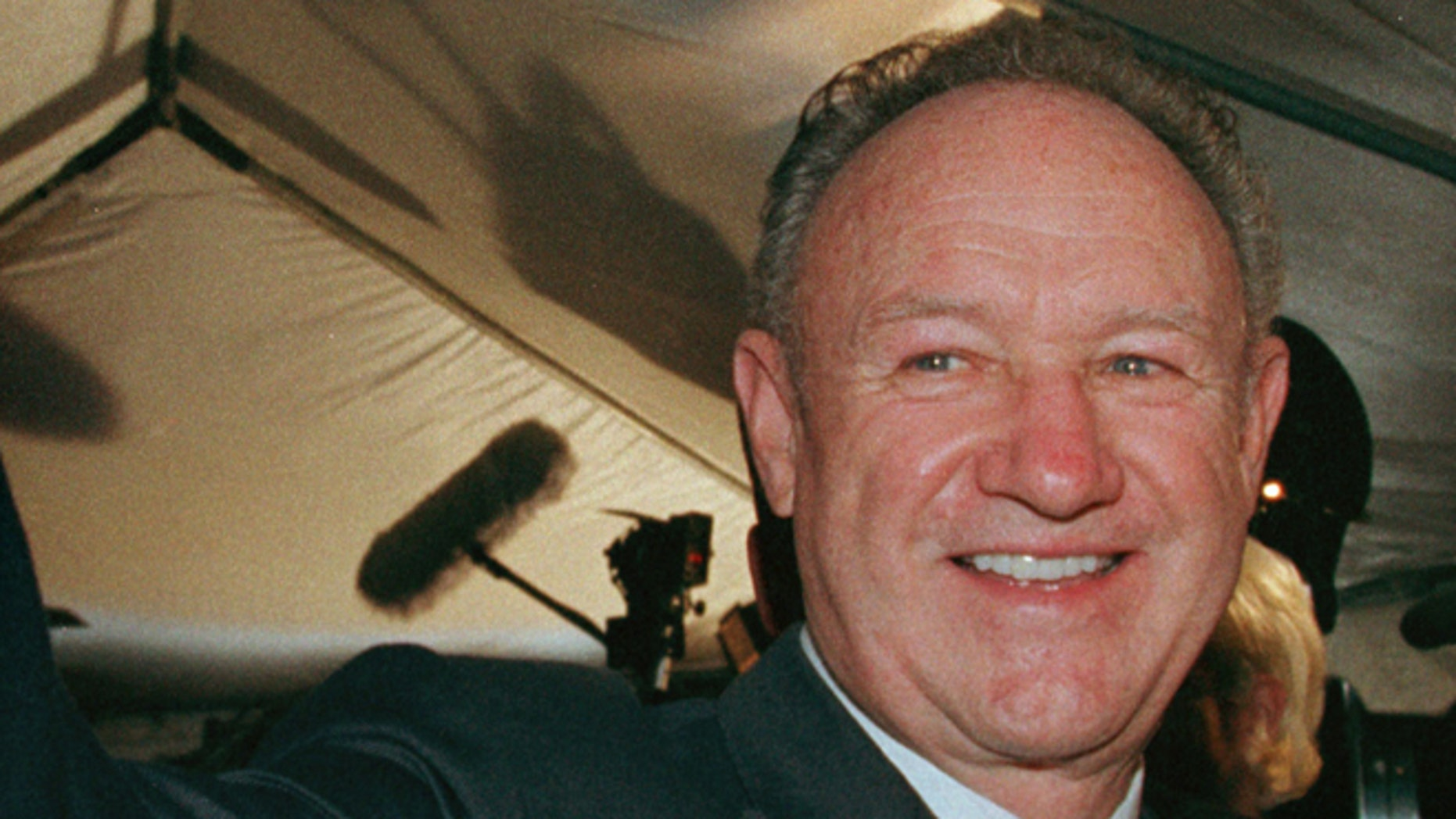 """Actor Gene Hackman waves to fans prior to the premiere of the animated film """"ANTZ"""" at the Toronto International Film Festival, September 19."""