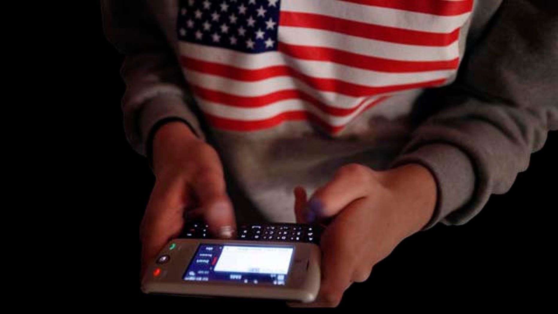 American competitor Kate Moore, 16, texts friends before the start of the LG Mobile Worldcup World  Championship in New York, Thursday, Jan. 14, 2010.  The Koreans won the top prize in the competition, which tested the speed and accuracy of the participants typing messages on mobile phones.  (AP Photo/Seth Wenig)