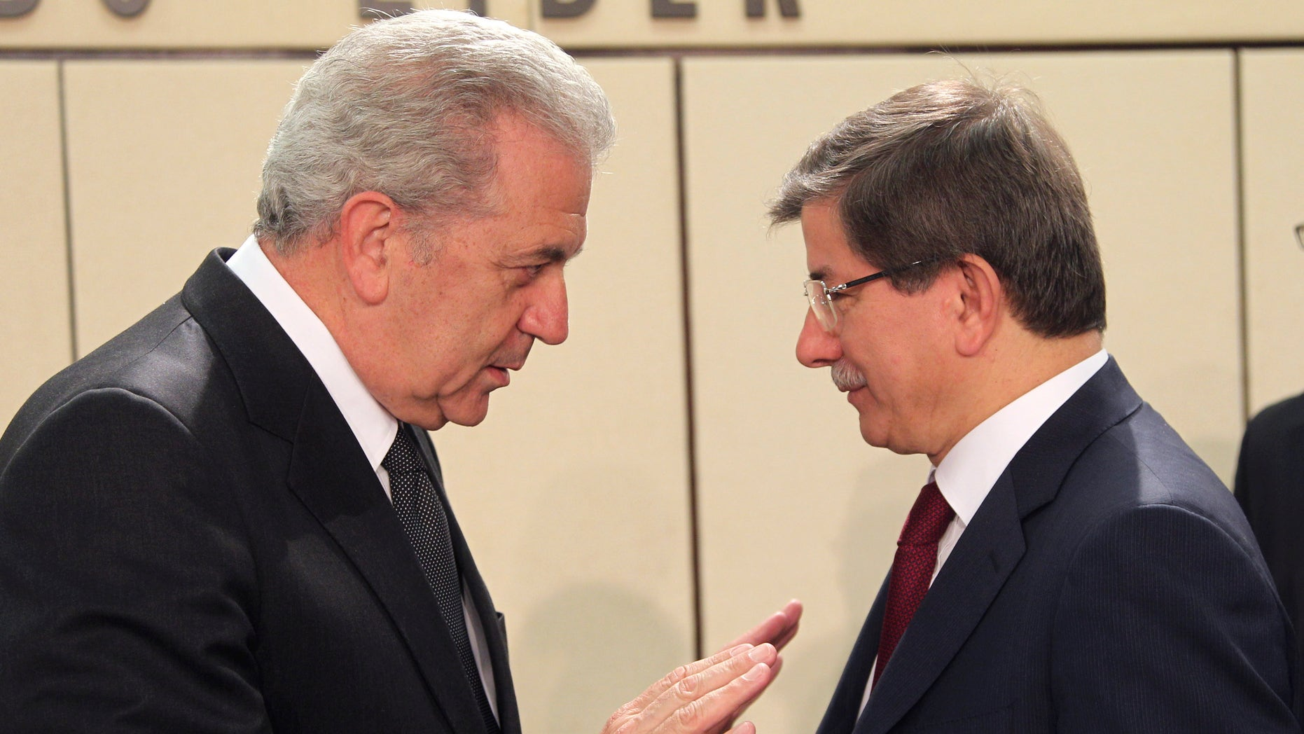 Greek Foreign Minister Dimitrios Avramopoulos, left, talks with Turkish counterpart Ahmet Davutoglu, during a NATO foreign ministers meeting at NATO headquarters in Brussels, Tuesday, April 23, 2013. NATO foreign ministers meet in Brussels to discuss the situation in Syria and Afghanistan. (AP Photo/Yves Logghe)