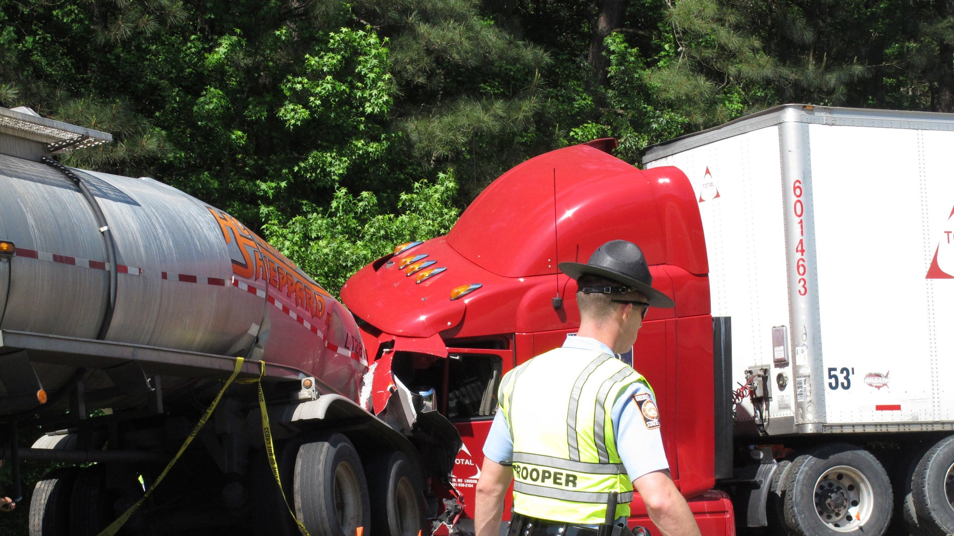 A Georgia state trooper works the scene of a deadly crash in April 2015.