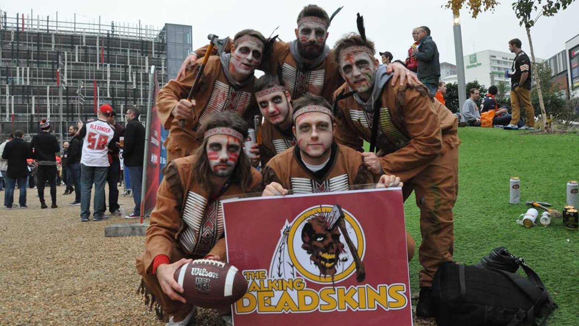 """Fans supporting the Redskins show off a Washington-themed homage to TV show """"The Walking Dead"""" before an NFL game in London."""
