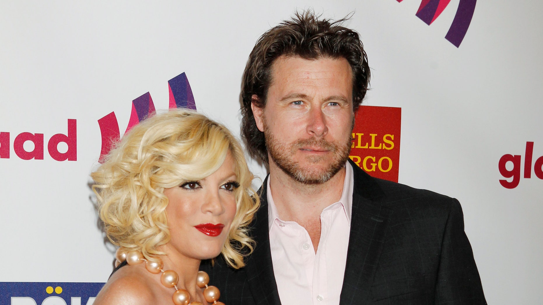 April 10, 2011. Actress Tori Spelling and husband Dean McDermott arrive at the 22nd annual Gay and Lesbian Alliance Against Defamation (GLAAD) Media Awards in Los Angeles, California.
