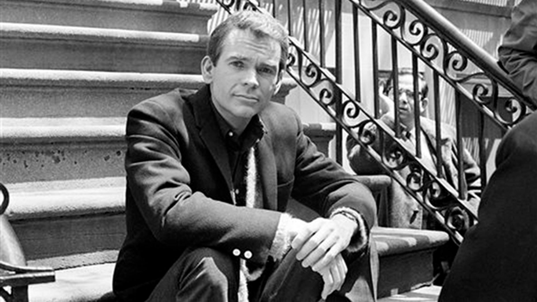 "FILE - In this May 24, 1966 file photo, actor Dean Jones, poses for a photo while on set for the Warner Bros. film, ""Any Wednesday,"" in New York. Jones, has died of Parkinson's Disease at age 84. He passed away on Tuesday, Sept. 1, 2015, in Los Angeles, publicist Richard Hoffman announced on Wednesday. (AP Photo/Dan Grossi, File)"