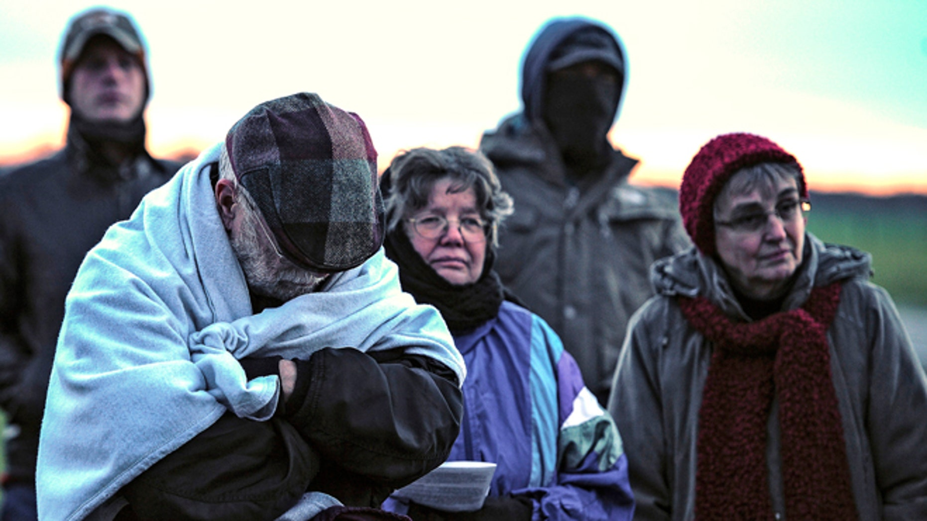 FILE: Jan. 7, 2014: A family from Daytona, Ohio protest against the death penalty in front of the Florida State Prison near Starke, Fla.
