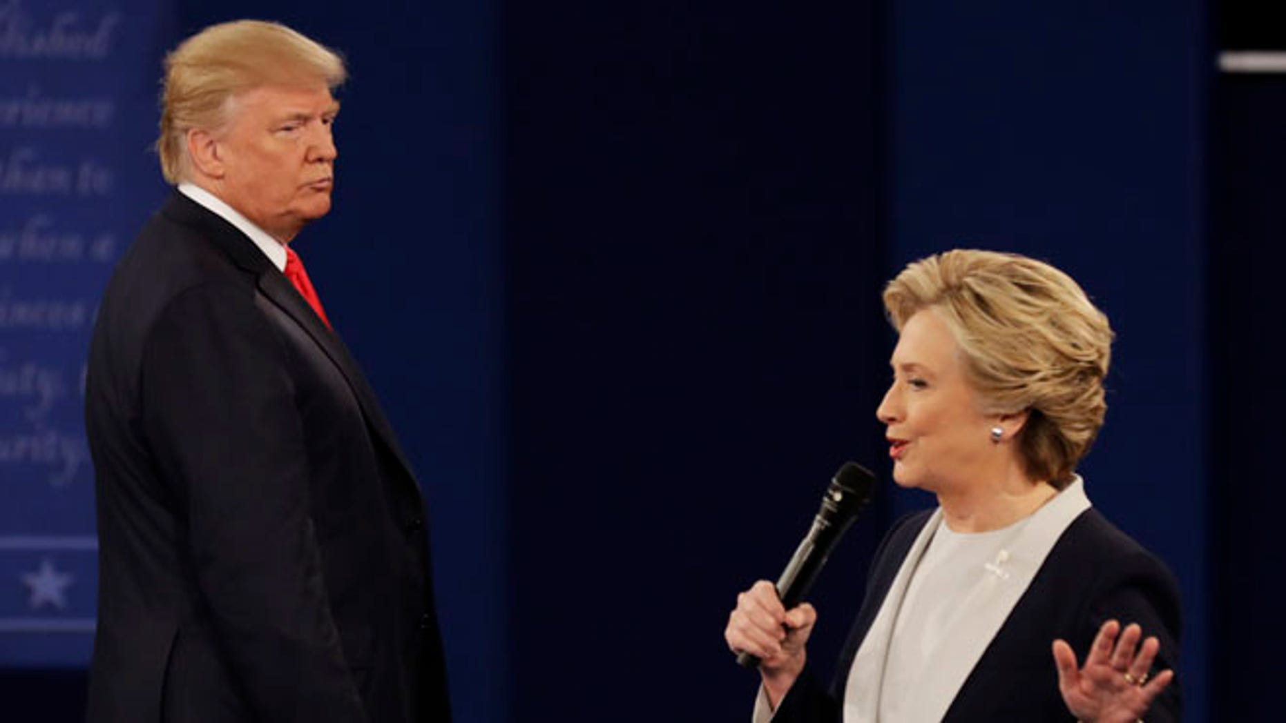 Republican presidential nominee Donald Trump listens to Democratic presidential nominee Hillary Clinton during the second presidential debate at Washington University in St. Louis, Sunday, Oct. 9, 2016. (AP Photo/Patrick Semansky)