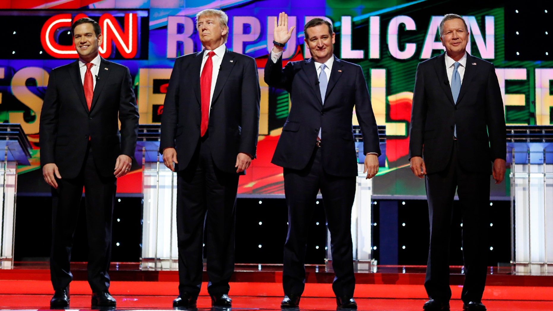 Republican U.S. presidential candidates (L-R) Marco Rubio, Donald Trump, Ted Cruz and John Kasich stand together onstage at the start of the Republican candidates debate sponsored by CNN at the University of Miami in Miami, Florida, March 10, 2016.  REUTERS/Joe Skipper - RTSA9ZC