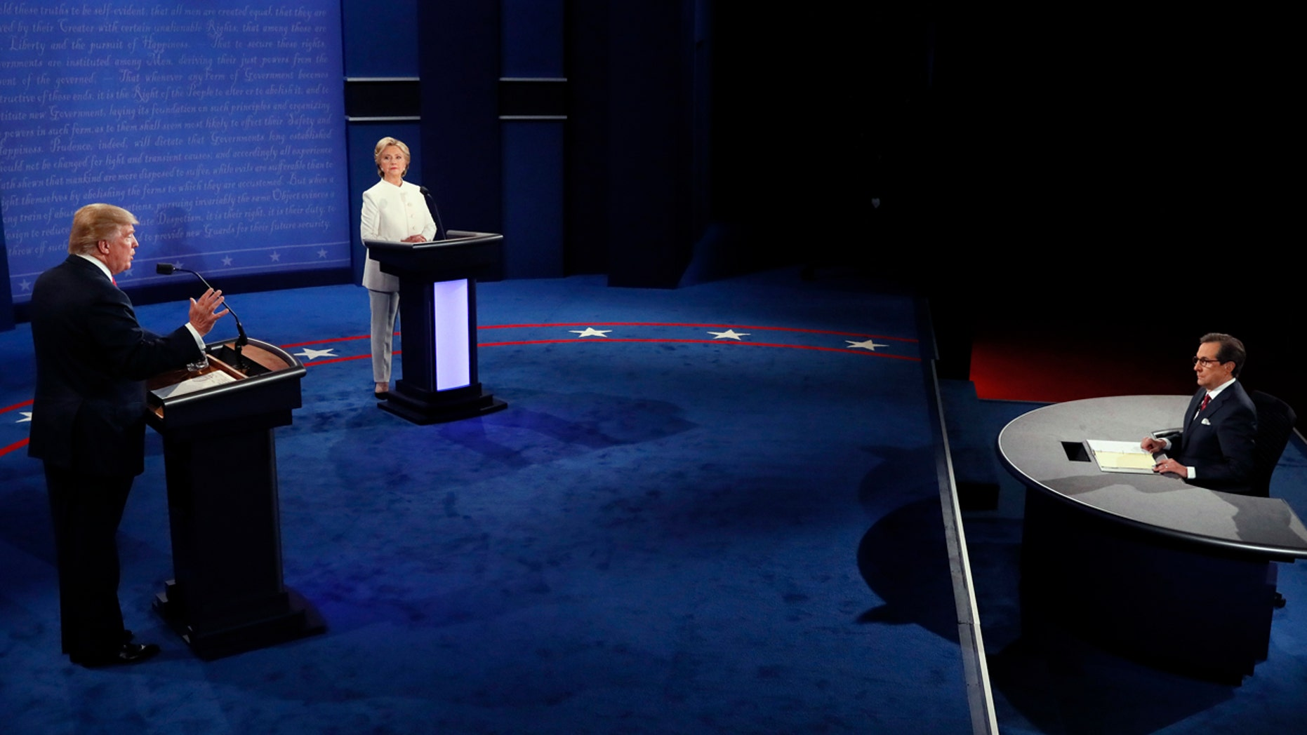 Democratic presidential nominee Hillary Clinton debates with Republican presidential nominee Donald Trump during the third presidential debate at UNLV in Las Vegas, Wednesday, Oct. 19, 2016. (Mark Ralston/Pool via AP)