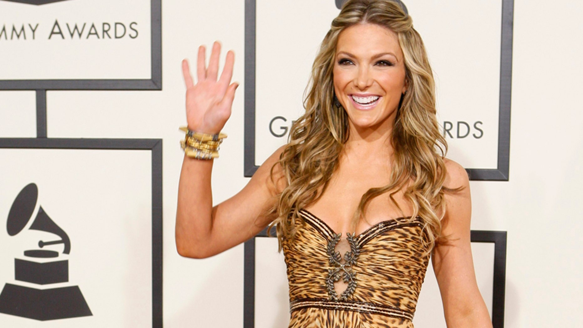 Entertainment television personality Debbie Matenopoulos arrives at the 50th Grammy Awards in Los Angeles February 10, 2008.     REUTERS/Danny Moloshok (UNITED STATES) - RTR1WXO7
