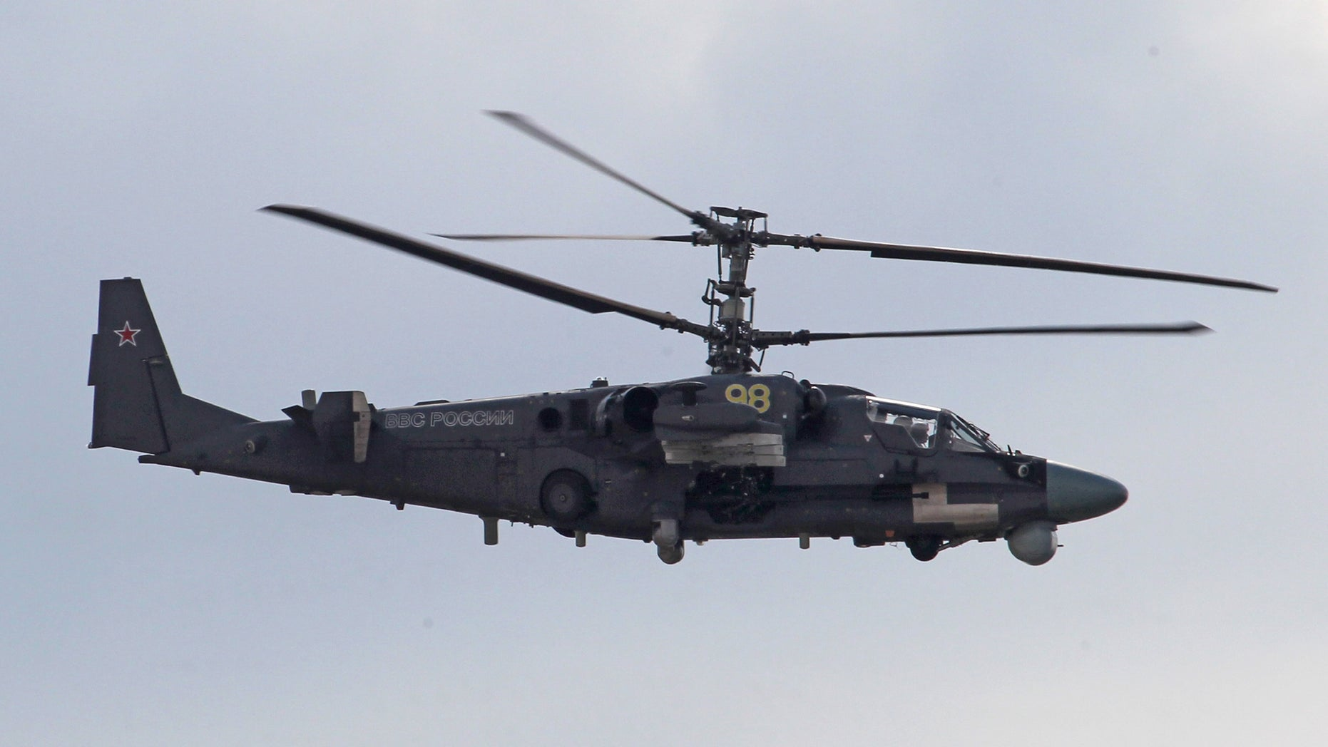 A Russian-made Ka-52 Alligator attack helicopter is seen in flight during a celebration marking the Russian air force's 100th anniversary in Zhukovsky, outside Moscow, Oct. 29, 2013.