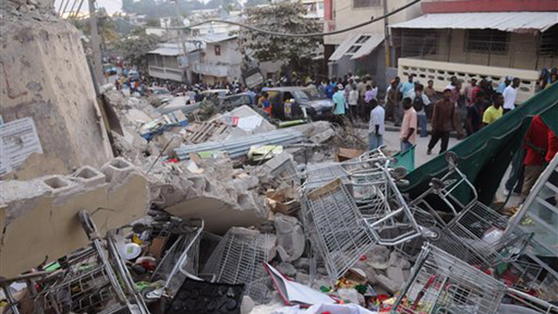 Debris lays in the street after an earthquake along the Delmas road in Port-au-Prince, Haiti, Wednesday, Jan. 13, 2010. (AP)