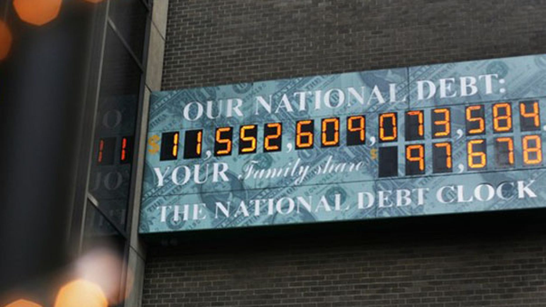 The National Debt Clock, which shows the U.S. national debt, is seen in New York City Aug. 24. That number has since surpassed $12 trillion. (Reuters Photo)