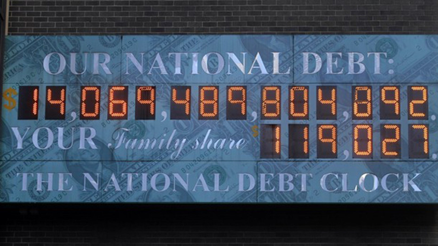 In this Feb. 14 photo, The National Debt Clock hangs from a building near Times Square in New York.