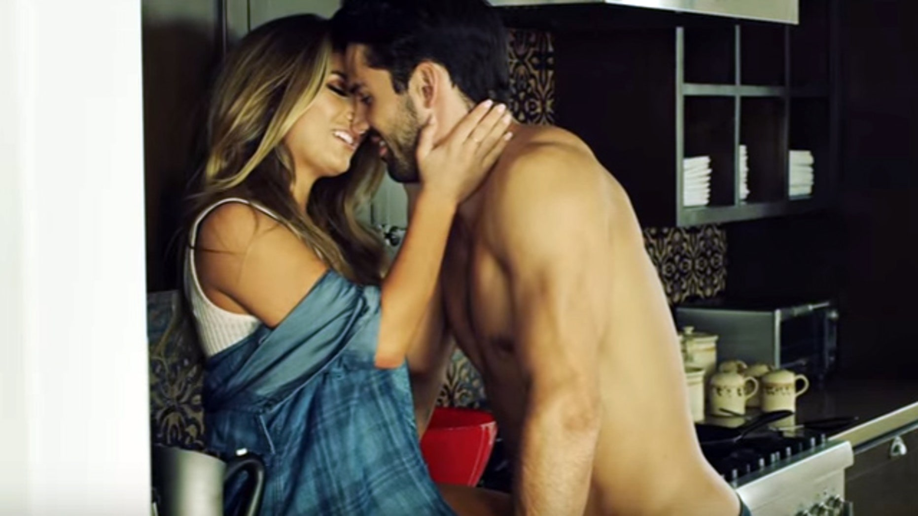 "Jessie James Decker (left) and husband Eric Decker in the music video ""Lights Down Low."""
