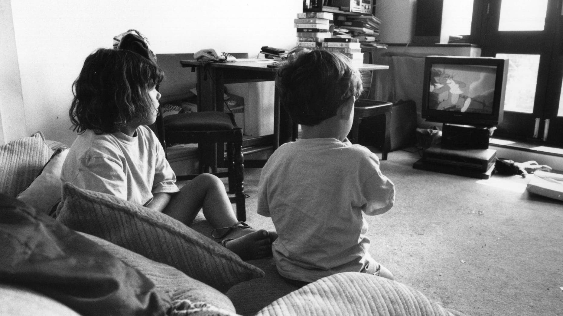 Two children watching a 'Tom And Jerry' cartoon on television, August 1995. (Photo by Steve Eason/Hulton Archive/Getty Images)