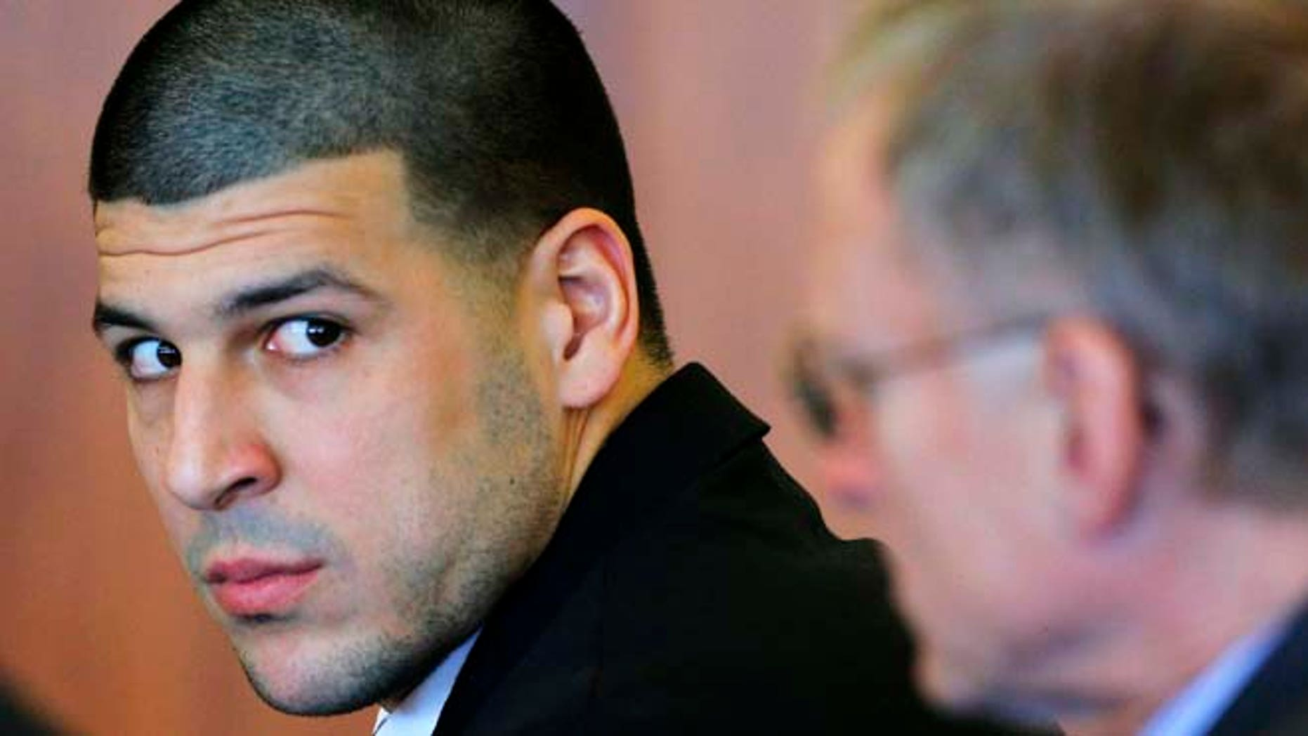 FILE 2014: Former New England Patriots tight end Aaron Hernandez, left, attends a pretrial hearing in Fall River, Mass.