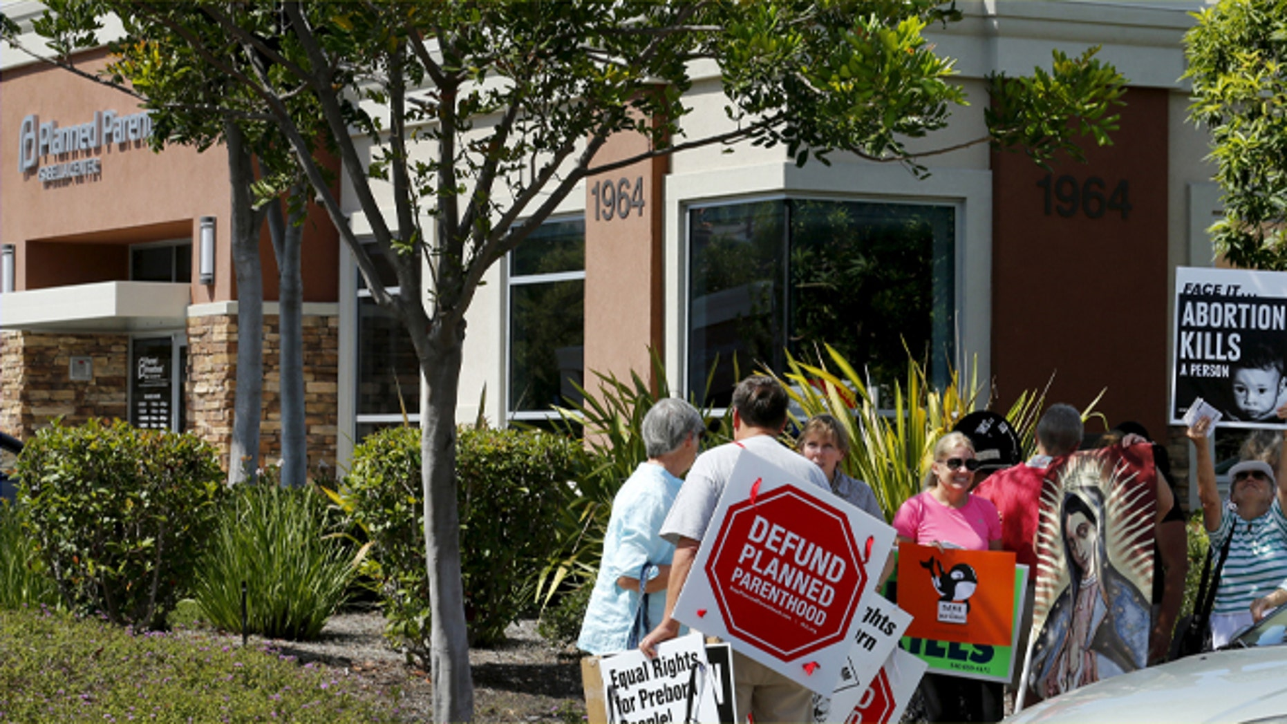 FILE: August 3, 2015: Protesters outside a Planned Parenthood clinic in Vista, California.