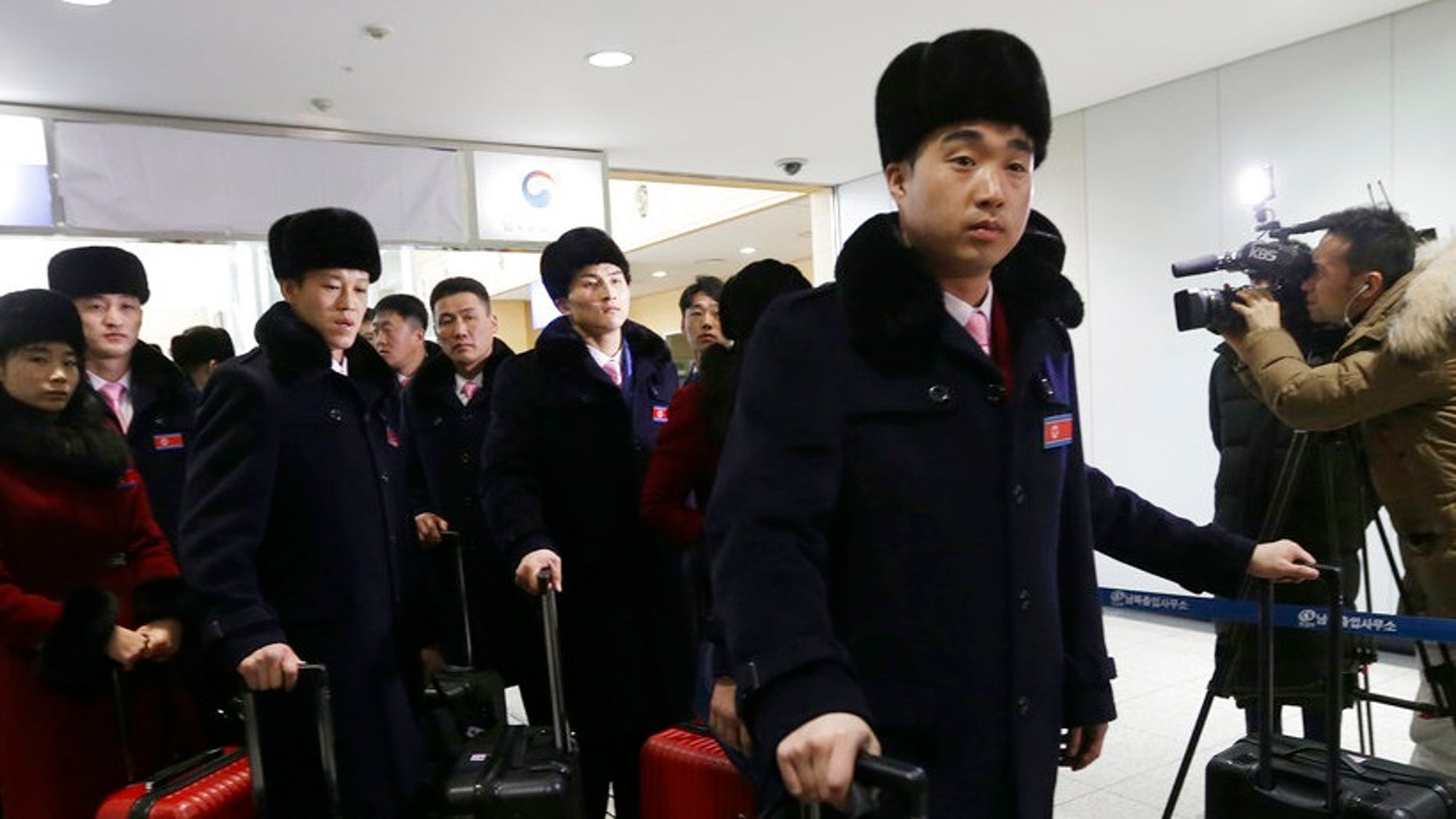 Members of North Korea's Taekwondo demonstration team, pictured, are part of the delegation whose Olympic expenses South Korea agreed to pay, according to a report.