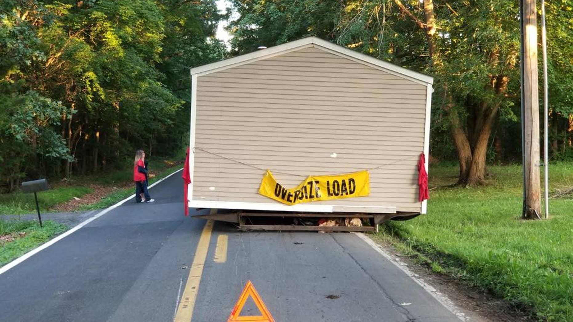 Investigators are trying to determine who abandoned a house on a street in Dover, Del.