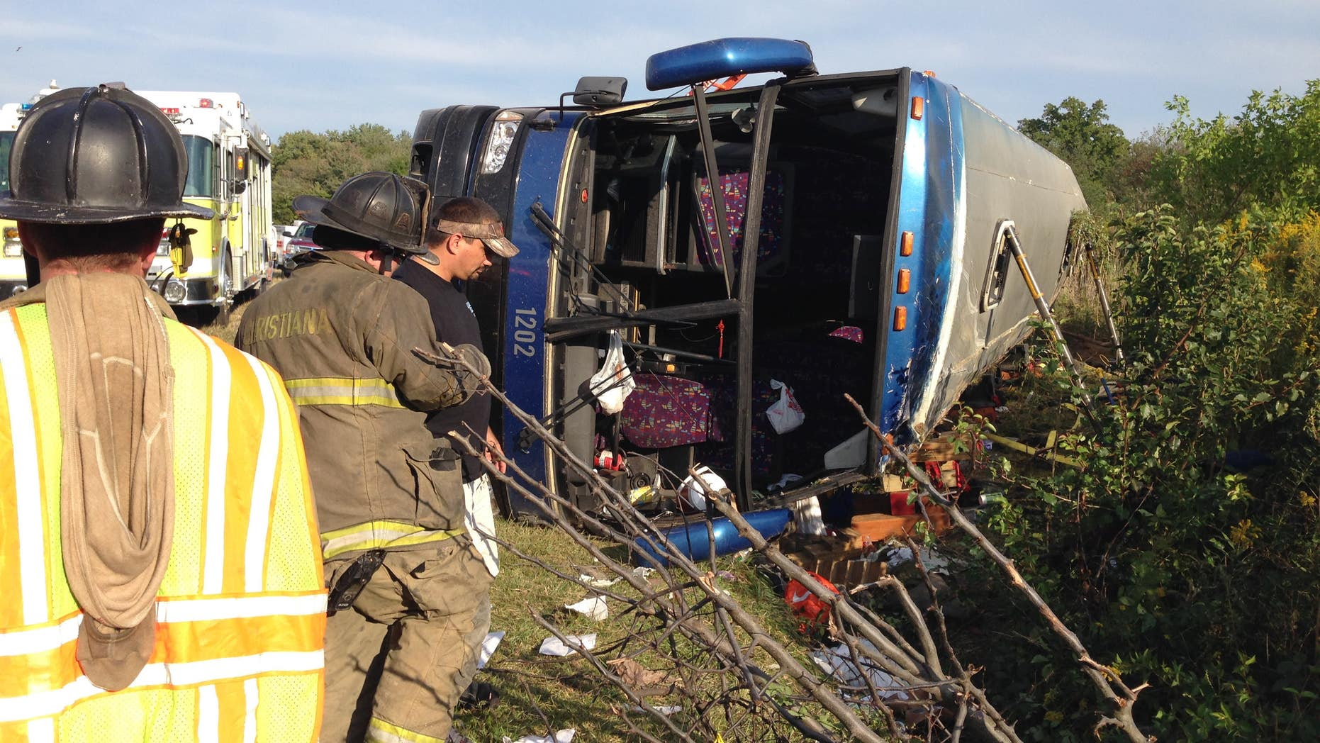 Sept. 21, 2014: Passengers from a tour bus are treated for injuries near the overturned bus at the Tybouts Corner on ramp from southbound Del. 1 to Red Lion Road.