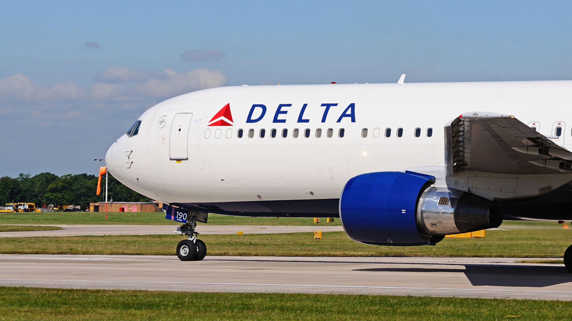 A Delta aircraft collided with an American plane waiting on the taxiway