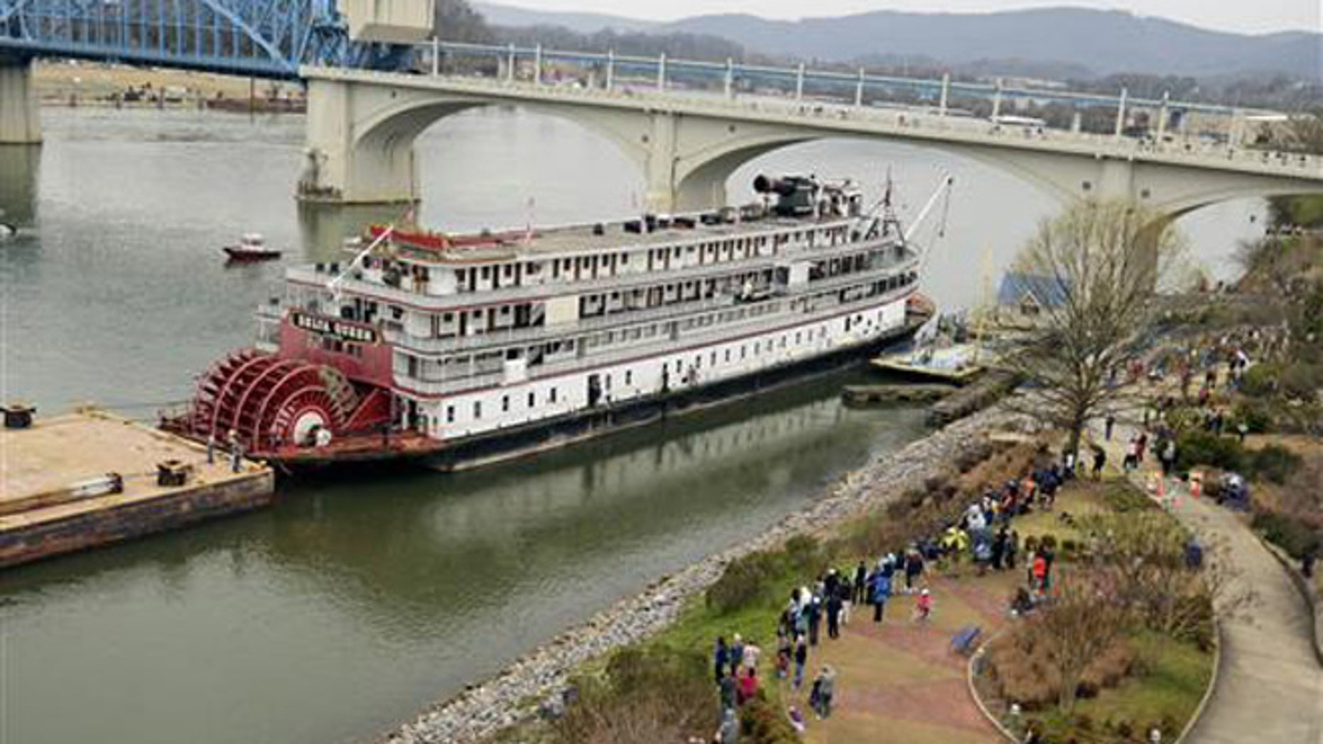 In this March 22, 2015 file photo, spectators line the bank of the Tennessee River as the Delta Queen riverboat waits to depart from Chattanooga, Tenn., on its way to Louisiana for restoration.