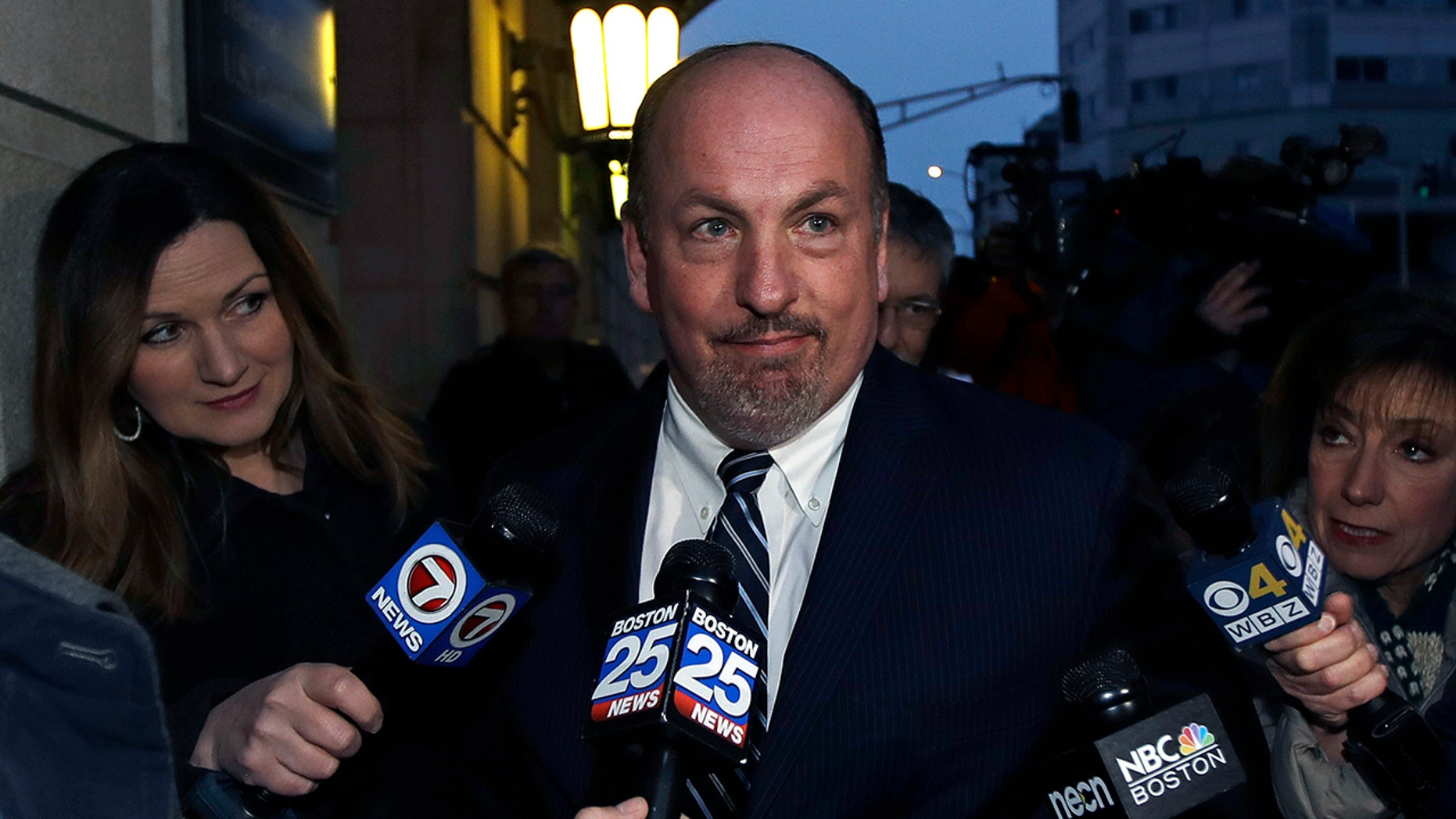 Former Massachusetts state Sen. Brian Joyce talks to reporters after leaving a federal courthouse in Worcester, Mass., Dec. 8, 2017.