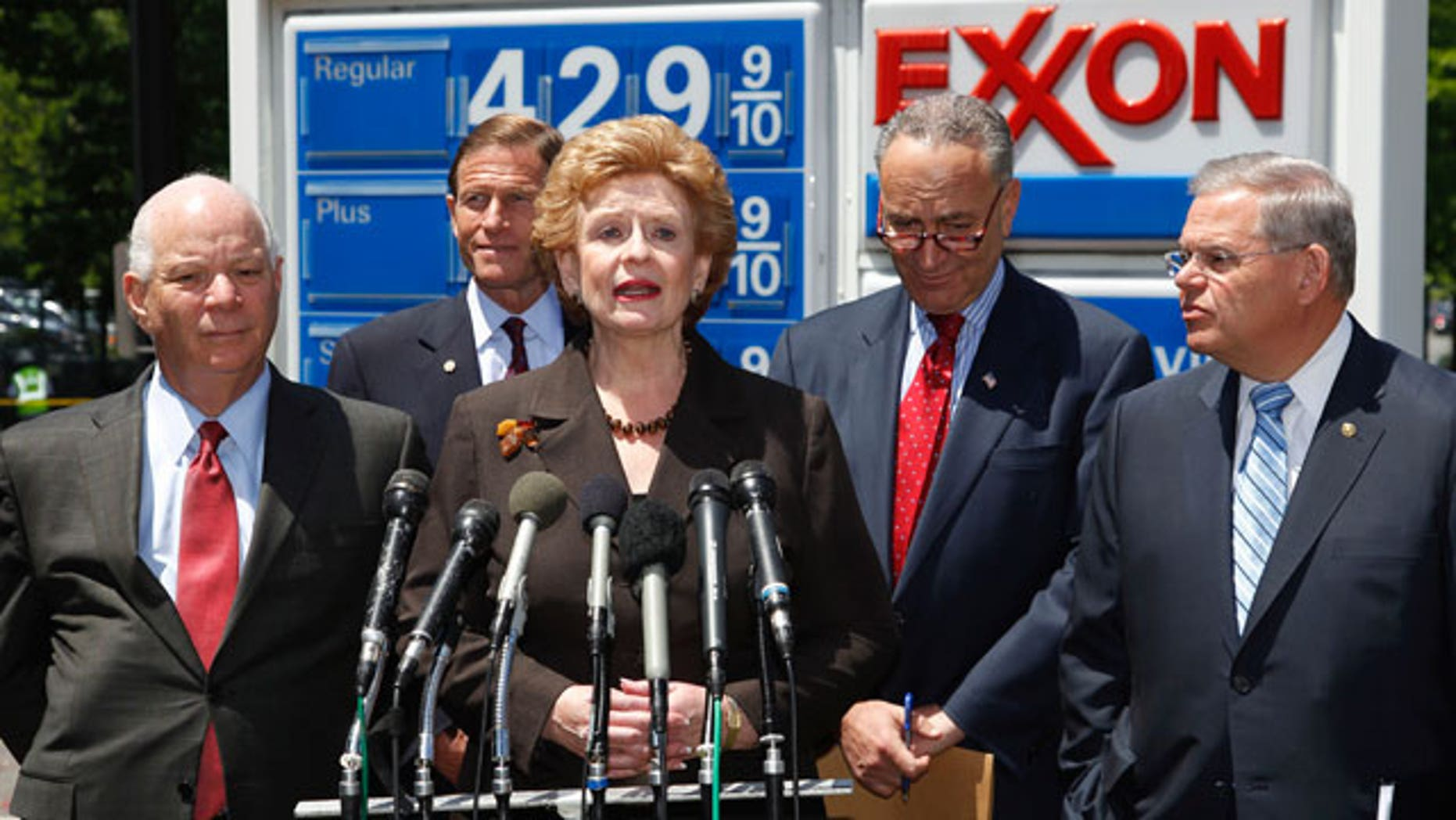 Democratic Senators, from left, Ben Cardin from Maryland, Richard Blumenthal from Connecticut, Debbie Stabenow from Michigan, Charles Schumer from New York, and Robert Menendez from New Jersey take part in a news conference at an Exxon gas station on Capitol Hill in Washington, Wednesday, May 11, 2011, to talk about oil industry subsidies to help reduce the deficit.