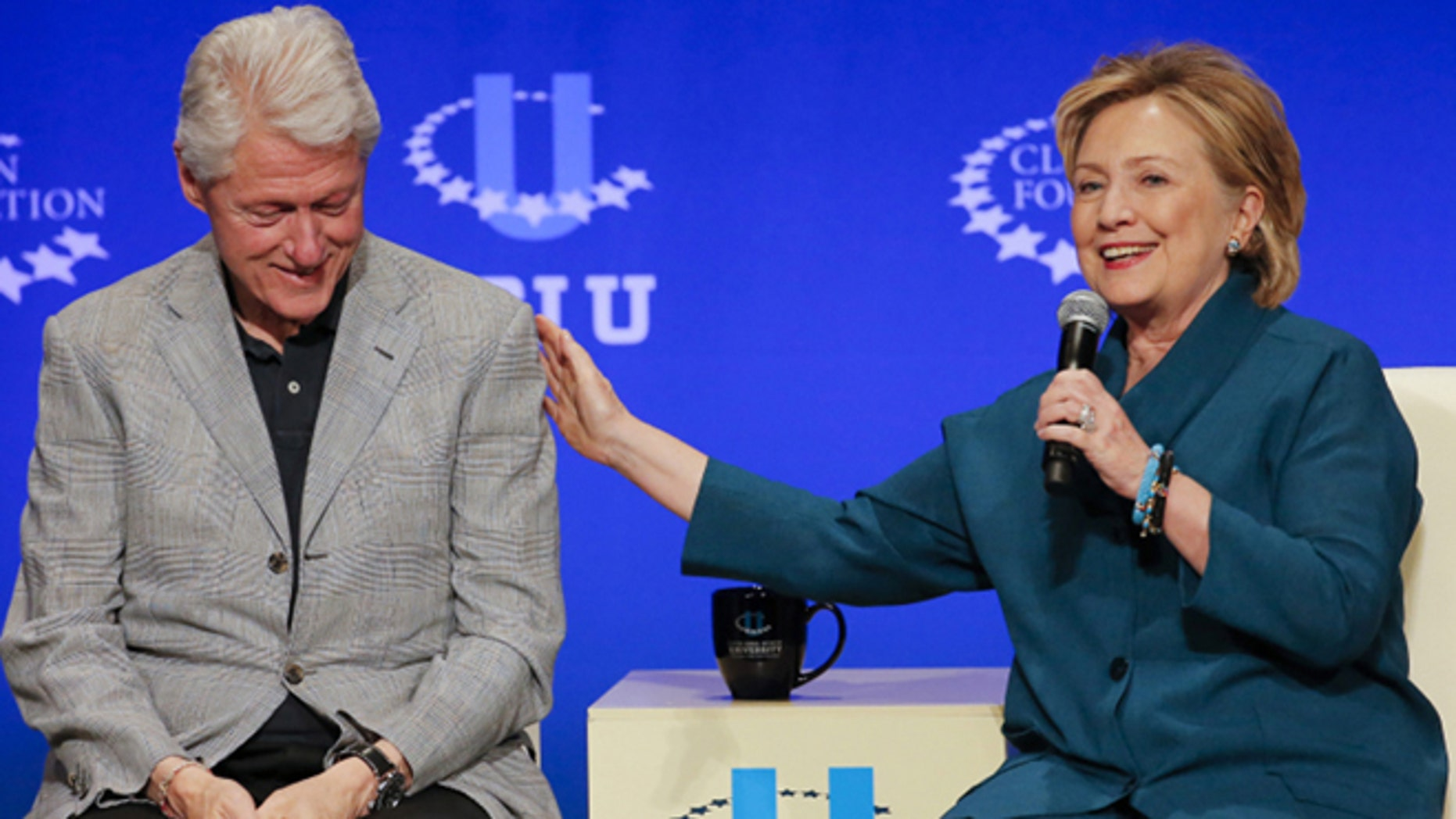 Former President Bill Clinton and Hillary Rodham Clinton are shown in this AP photo.