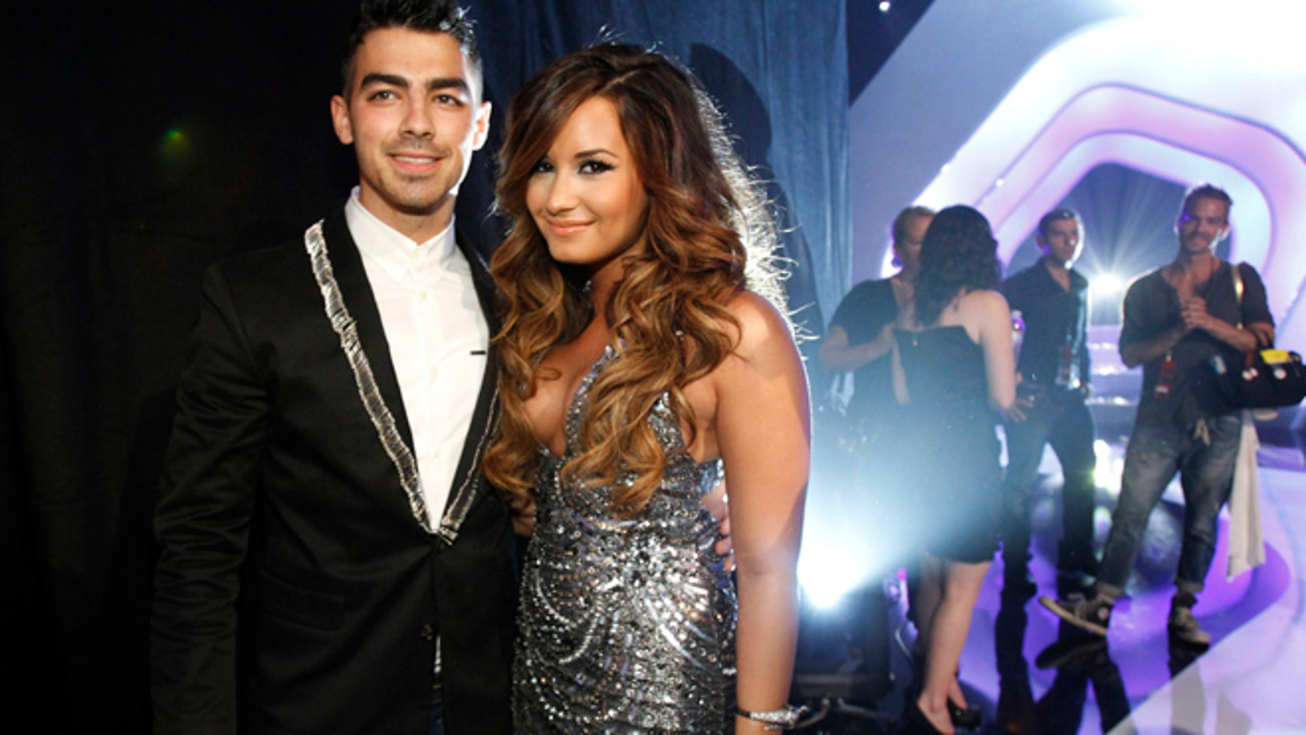 August 28, 2011. Singers Joe Jonas and Demi Lovato (R) arrive at the 2011 MTV Video Music Awards in Los Angeles.