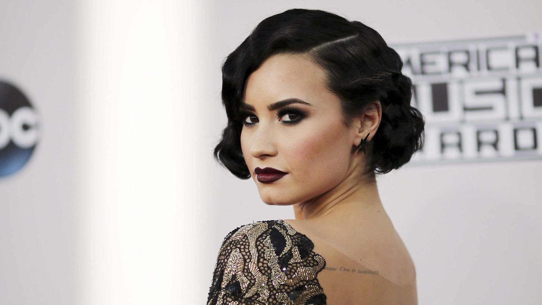November 22, 2015. Singer Demi Lovato arrives at the 2015 American Music Awards in Los Angeles, California.