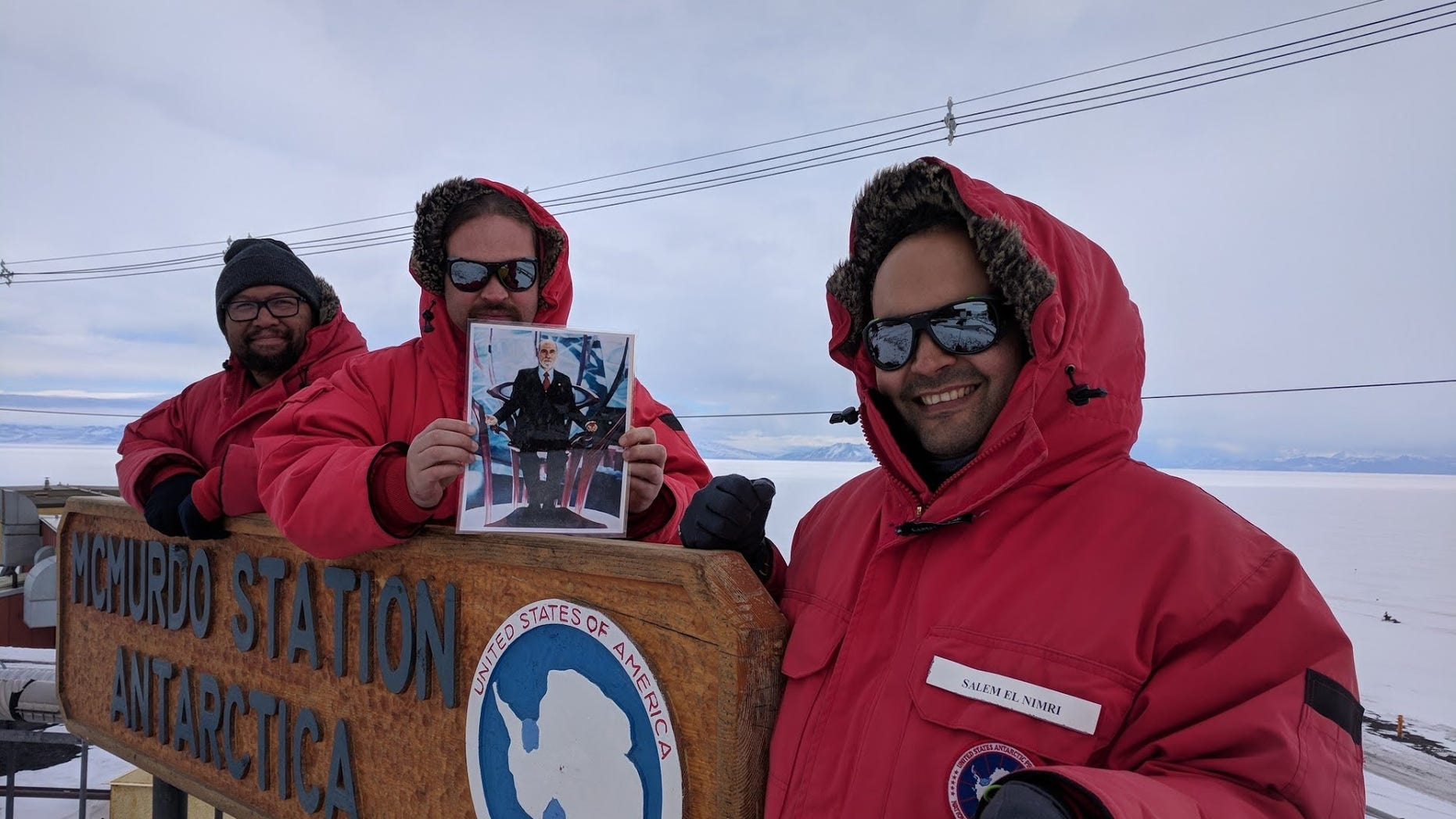 NASA engineers Mark Sinkiat, Peter Fetterer and Salem El-nimri pose at McMurdo Station in Antarctica with a picture of Vint Cerf, a visiting scientist at NASA's Jet Propulsion Laboratory, who helped develop the disruption-tolerant networking (DTN) technology that sent the selfie to the International Space Station.